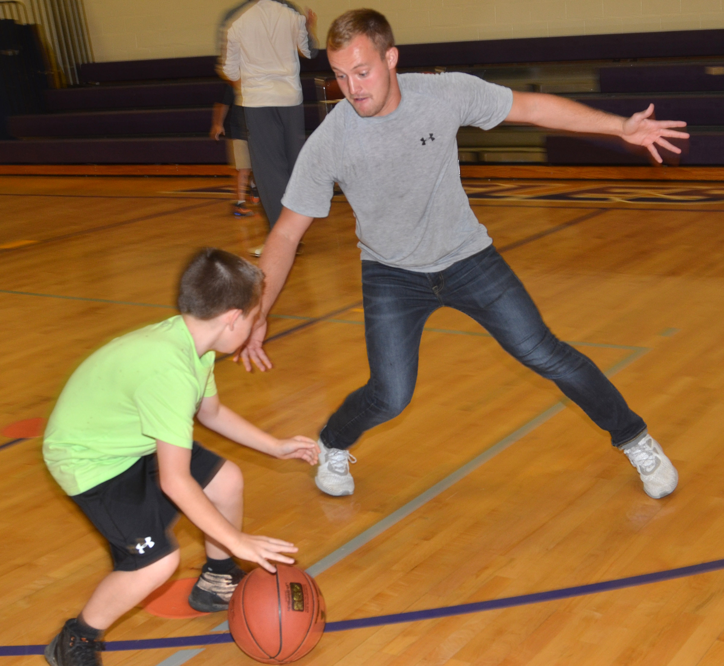 CES third-grader Lanigan Price plays basketball with Campbellsville University student Bradley Bates, who is also an AmeriCorps tutor at CES.