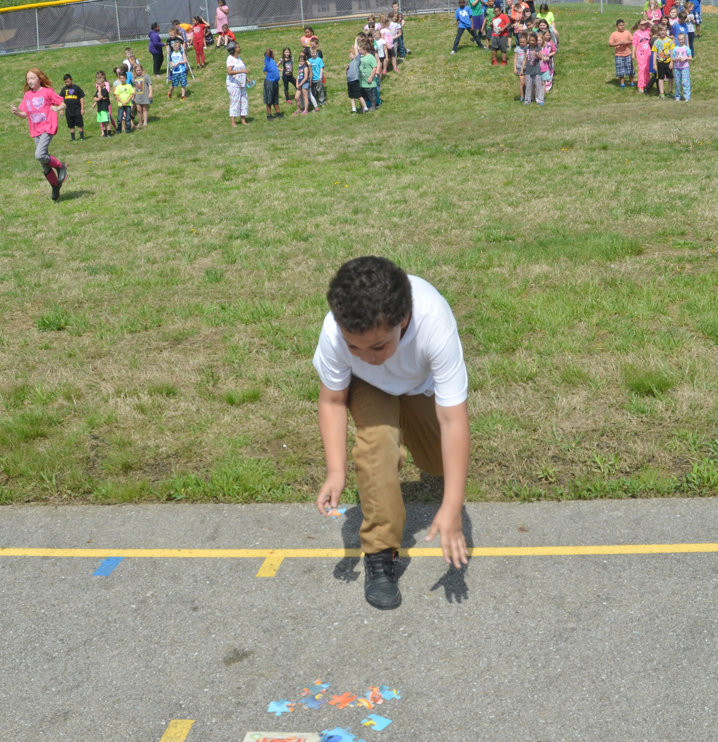 CES third-grader Brian Stone races to his class's puzzle.