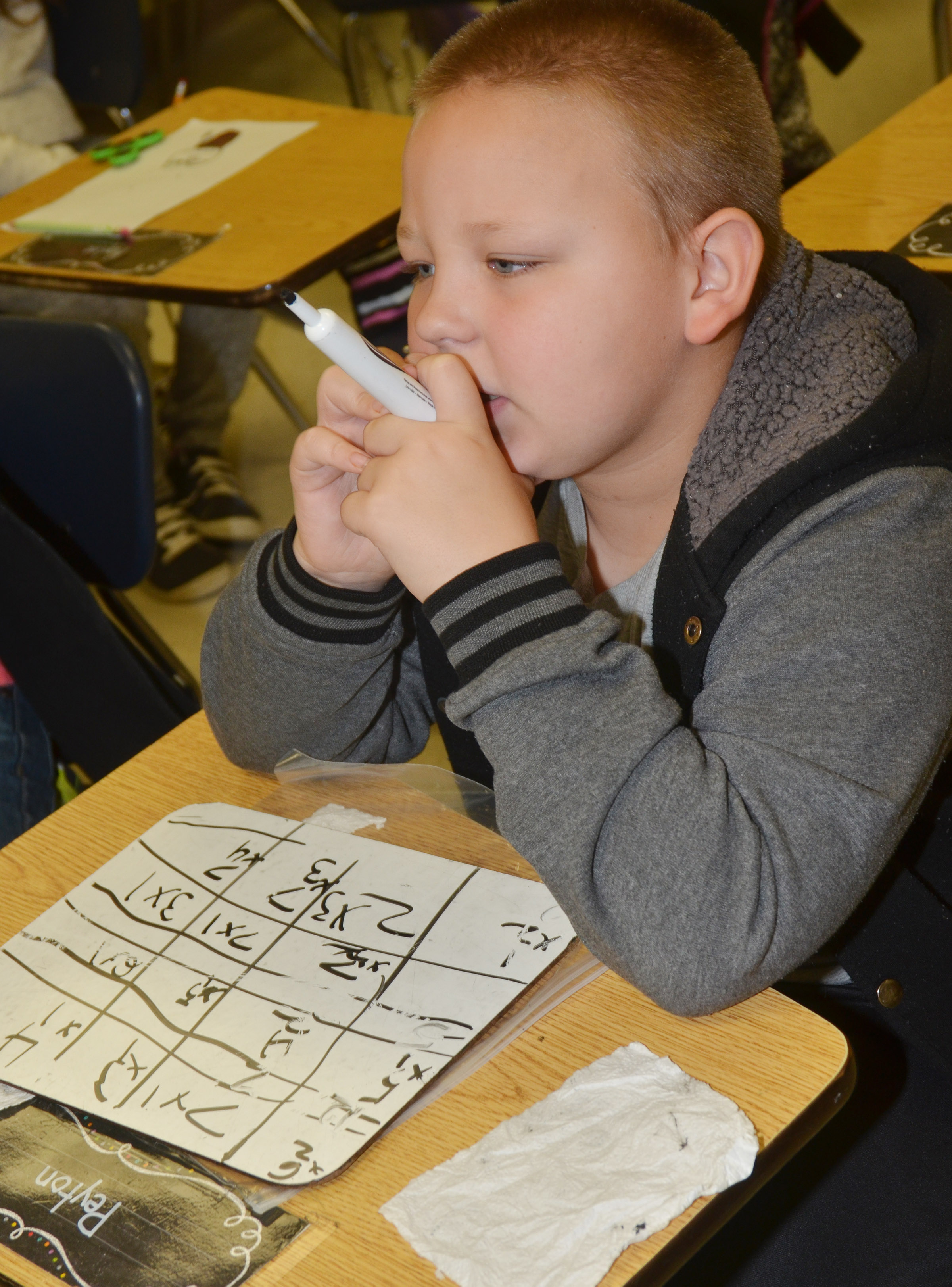 CES third-grader Peyton Mitchell thinks about an answer to a multiplication problem.