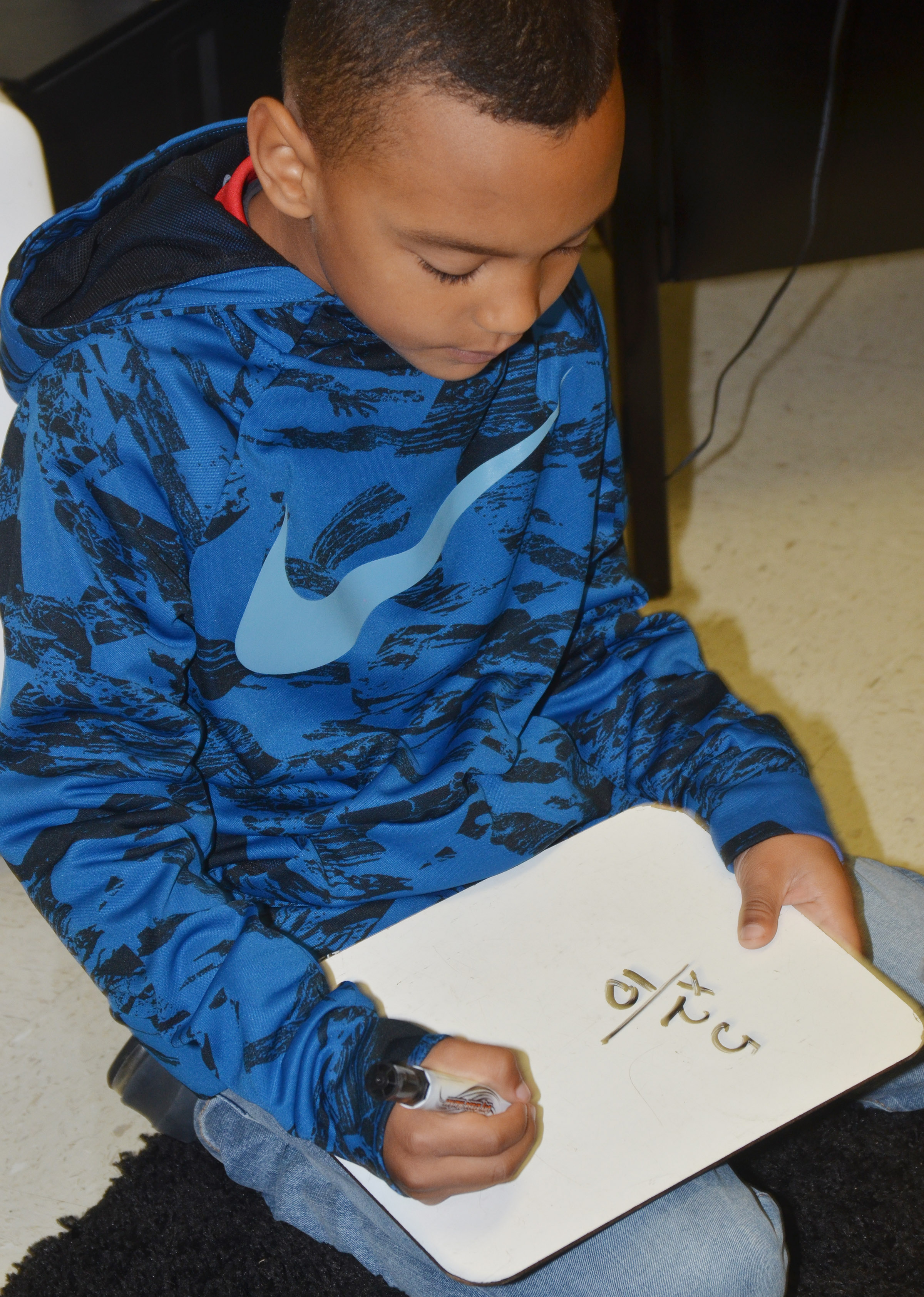 CES third-grader Maddox Hawkins works a multiplication problem.