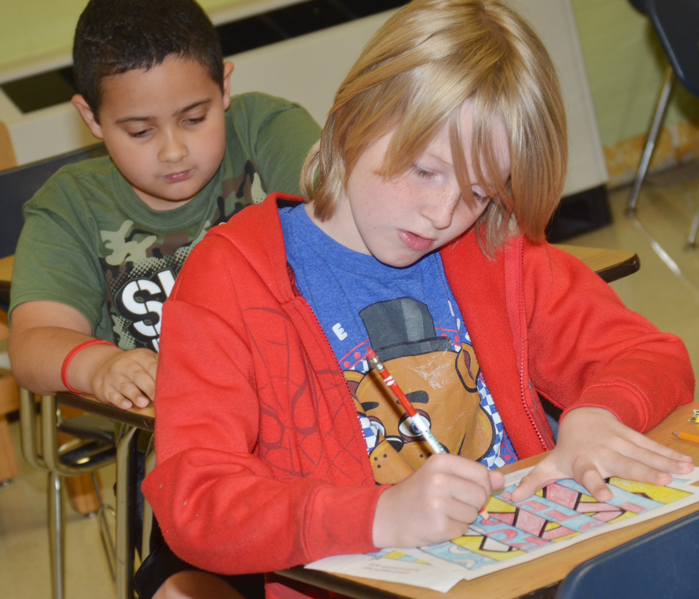 CES fourth-graders Tayshaun Hickman, at left, and Devin Underwood color their agamographs.