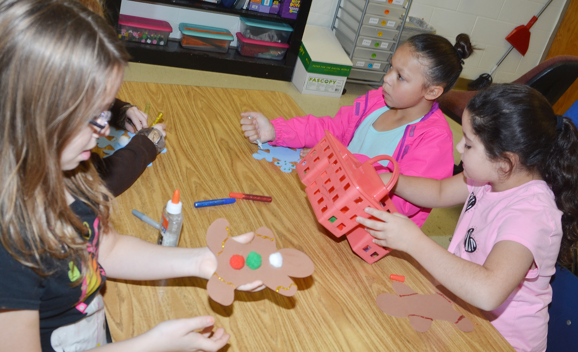 CES fourth-graders, from left, McKailynn Grubaugh, Breona Bridgewater and Brooklyn Boudreaux make gingerbread ornaments.