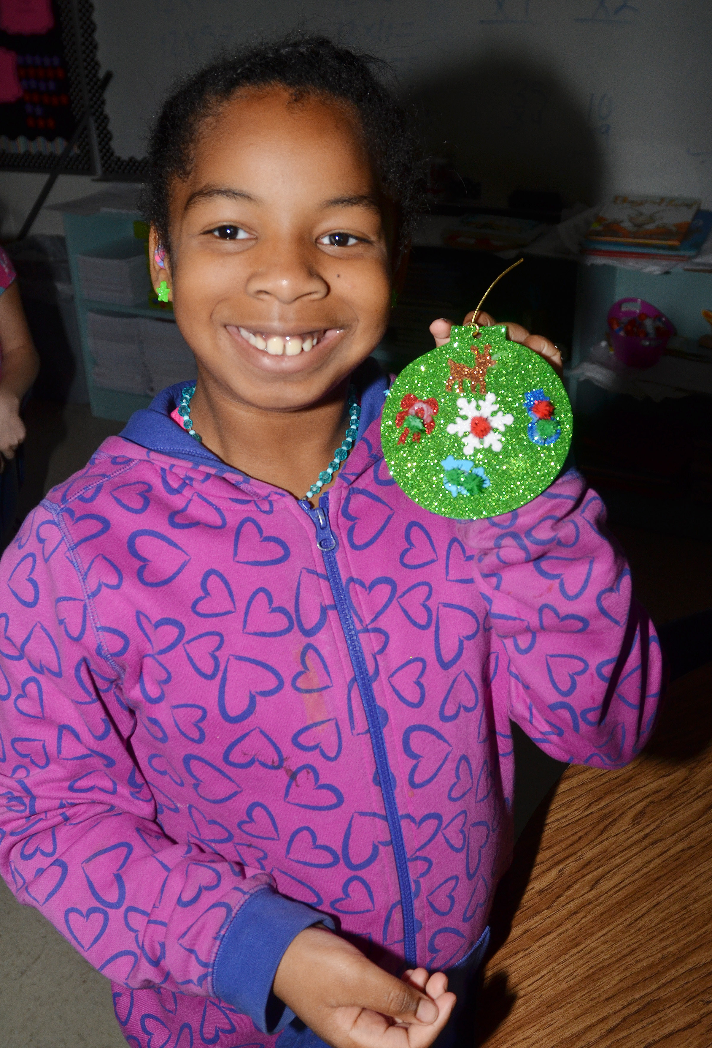 CES fourth-grader KaMiya Williams holds her ornament.