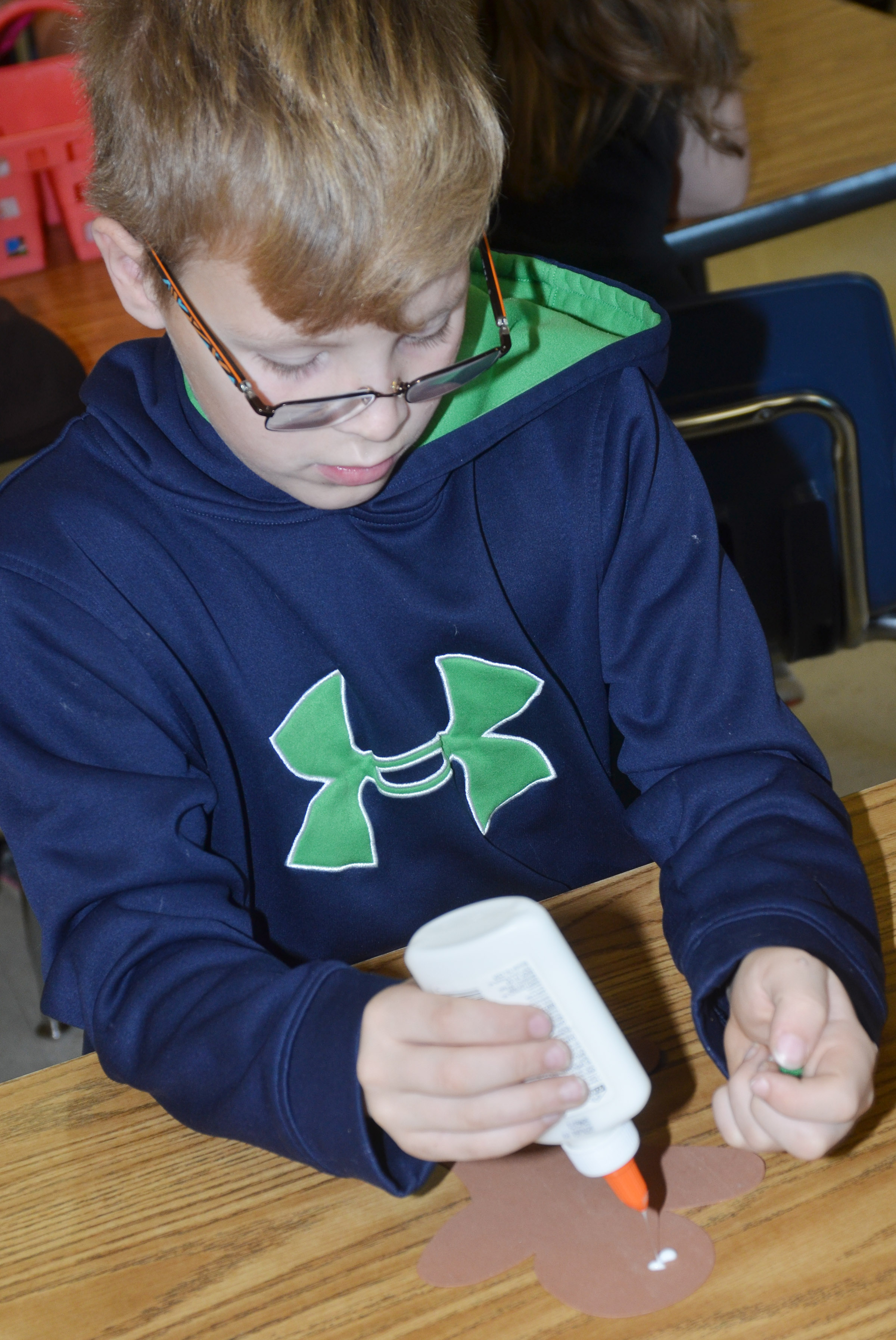 CES fourth-grader Ethan Irwin makes his gingerbread ornament.
