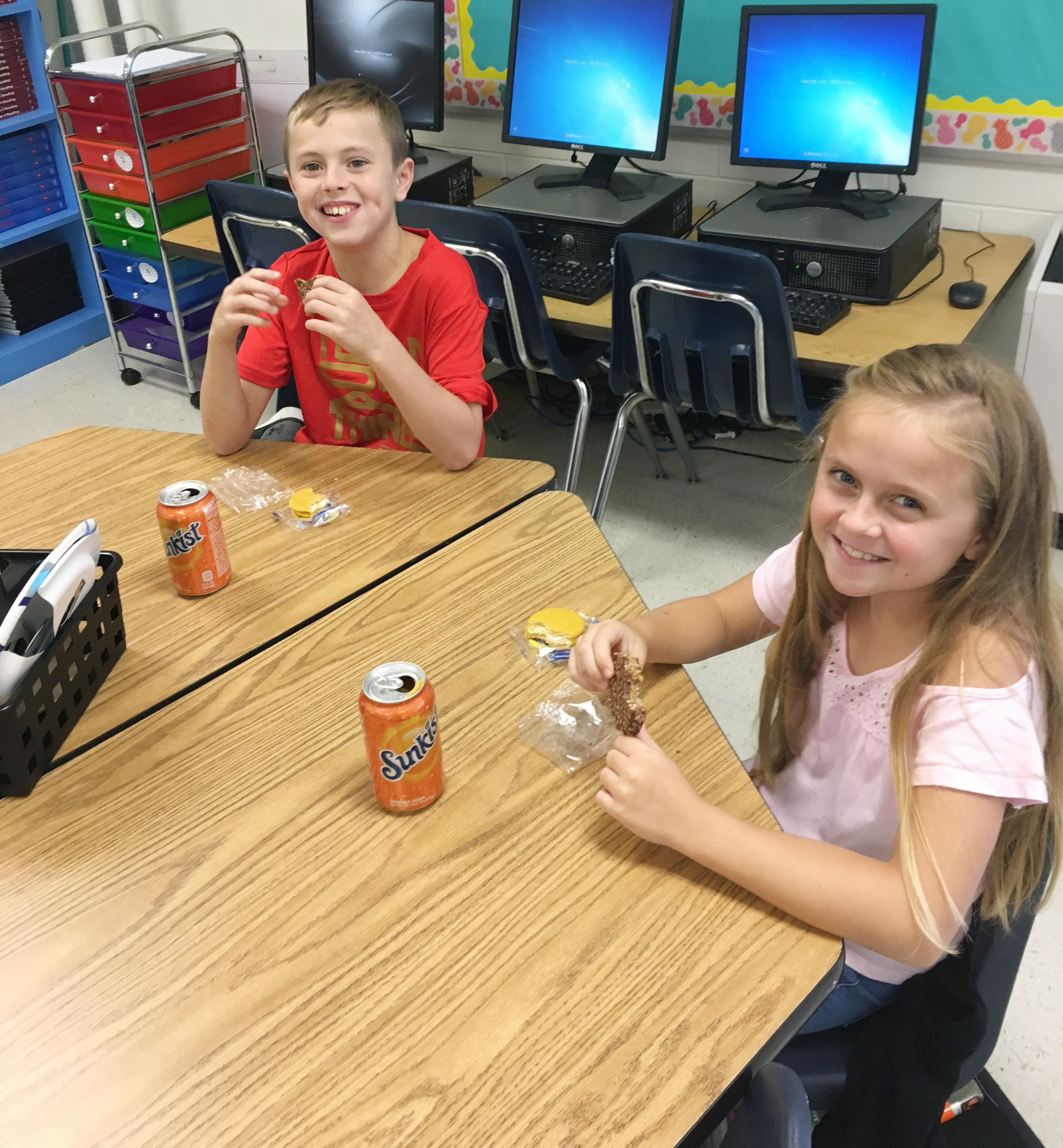 CES fourth-graders Keaton Hord, at left, and Kennedy Griffiths enjoy their Star Crunch and Moon Pie snacks.