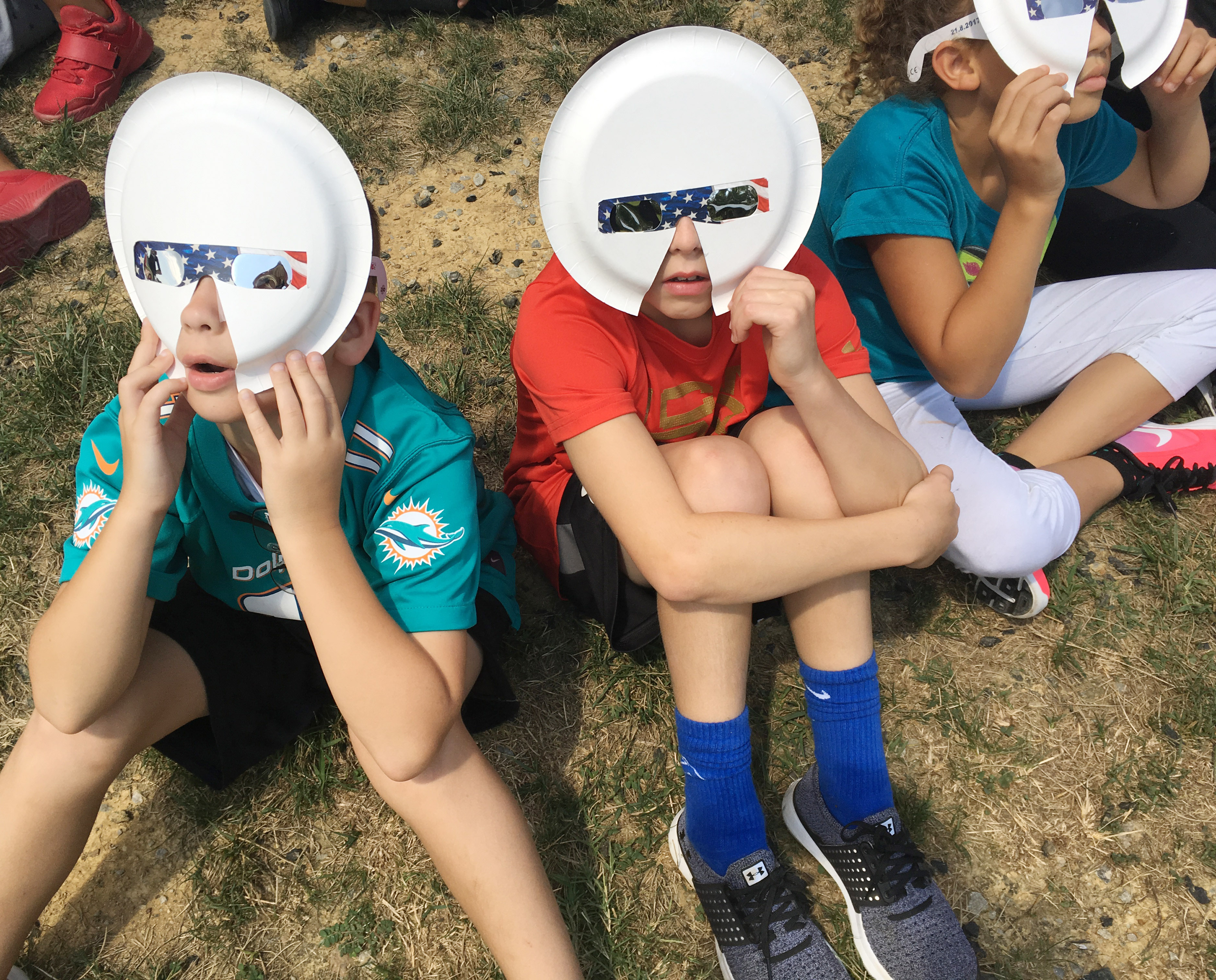CES fourth-graders Cameron Estes, at left, and Keaton Hord watch the solar eclipse.