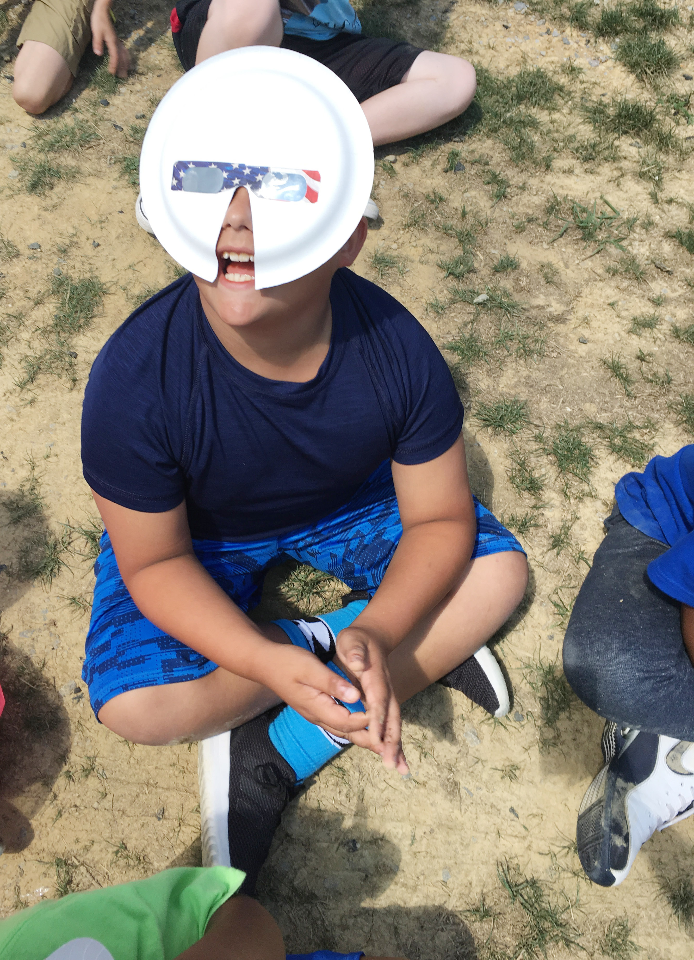 CES fourth-grader Brayden Paiz watches the solar eclipse.