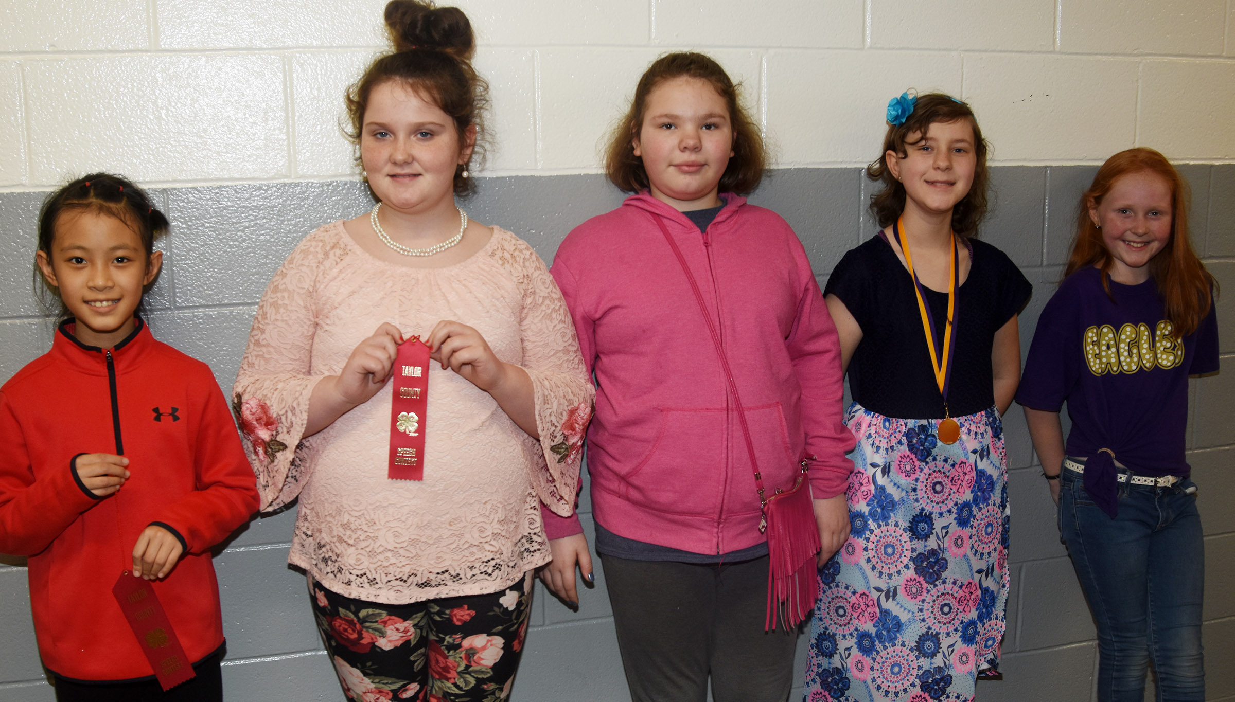 From left, CES fourth-graders Demi Hao and Madison Philpott, fifth-graders Averi Perkins and Bryanna Fitzgerald and fourth-grader Nora Harris participated in the Taylor County 4-H Talk Meet. Hao and Philpott won red ribbons and Perkins, Fitzgerald and Harris were awarded blue ribbons.