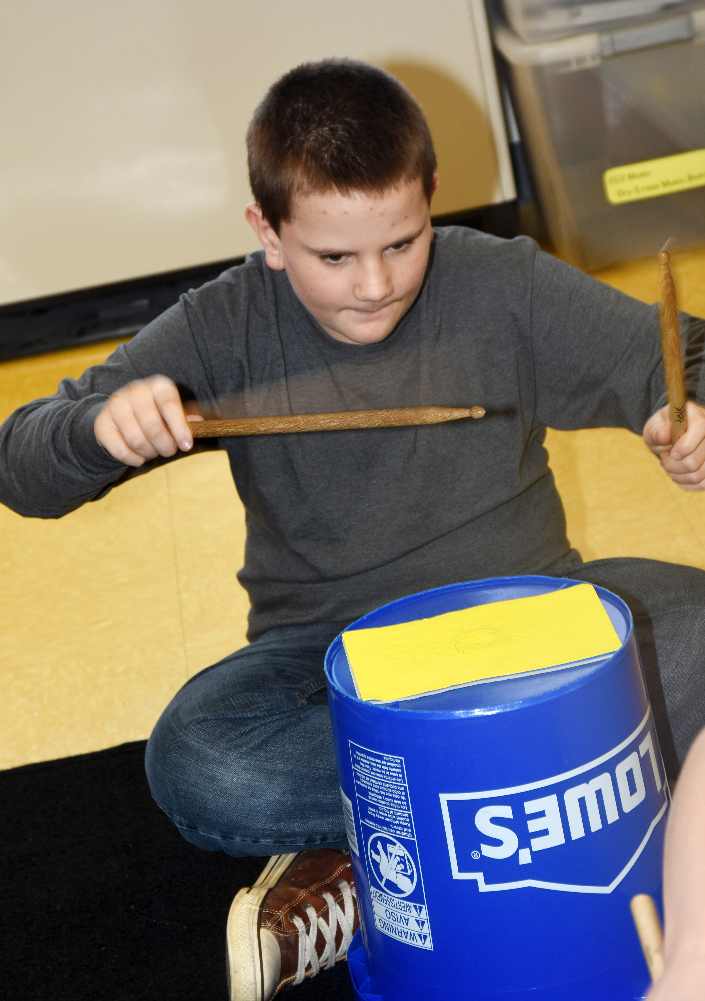 CES fifth-grader Kaleb Martin plays the bucket drums.