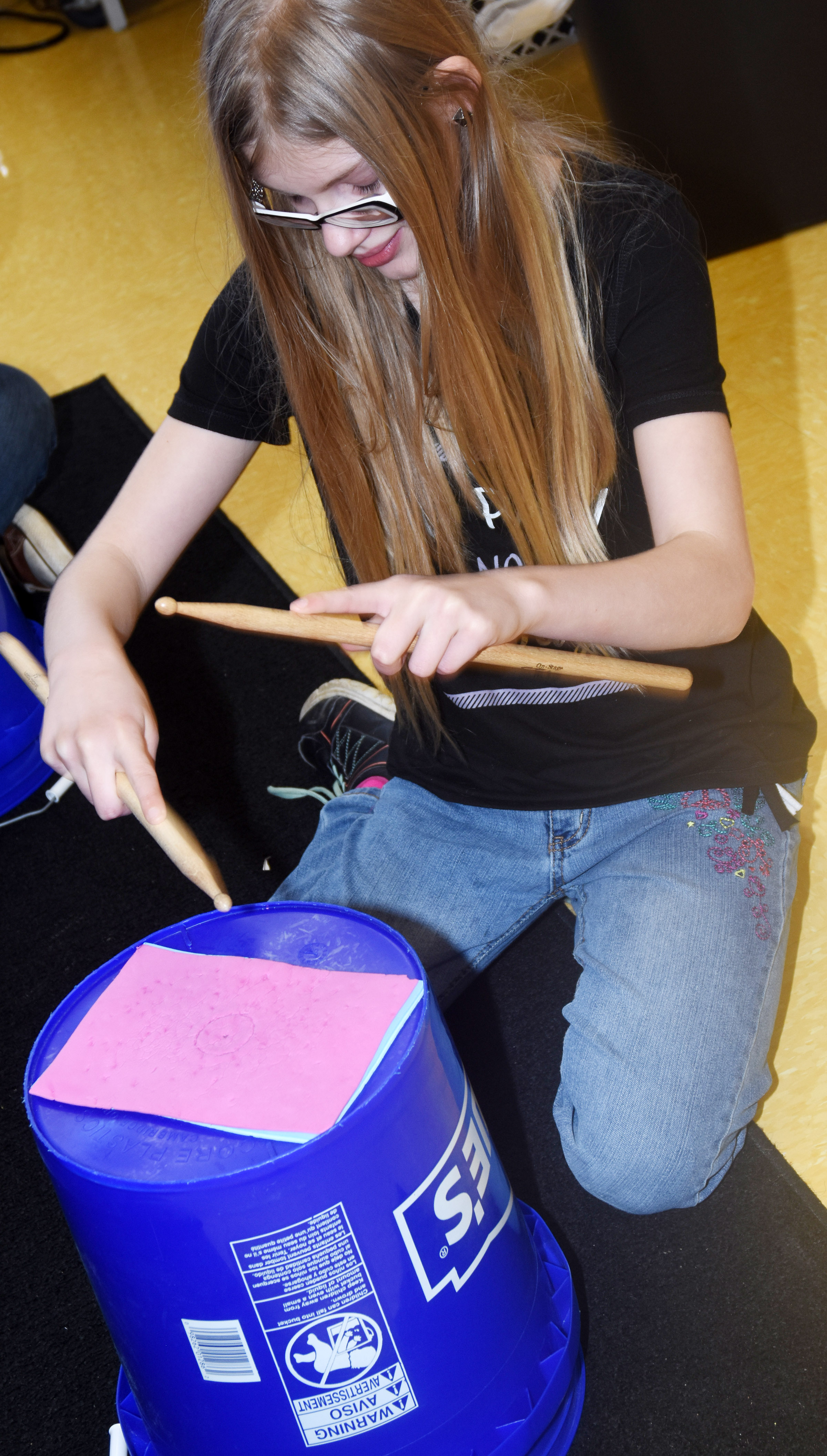 CES fifth-grader Payton Releford plays the bucket drums.