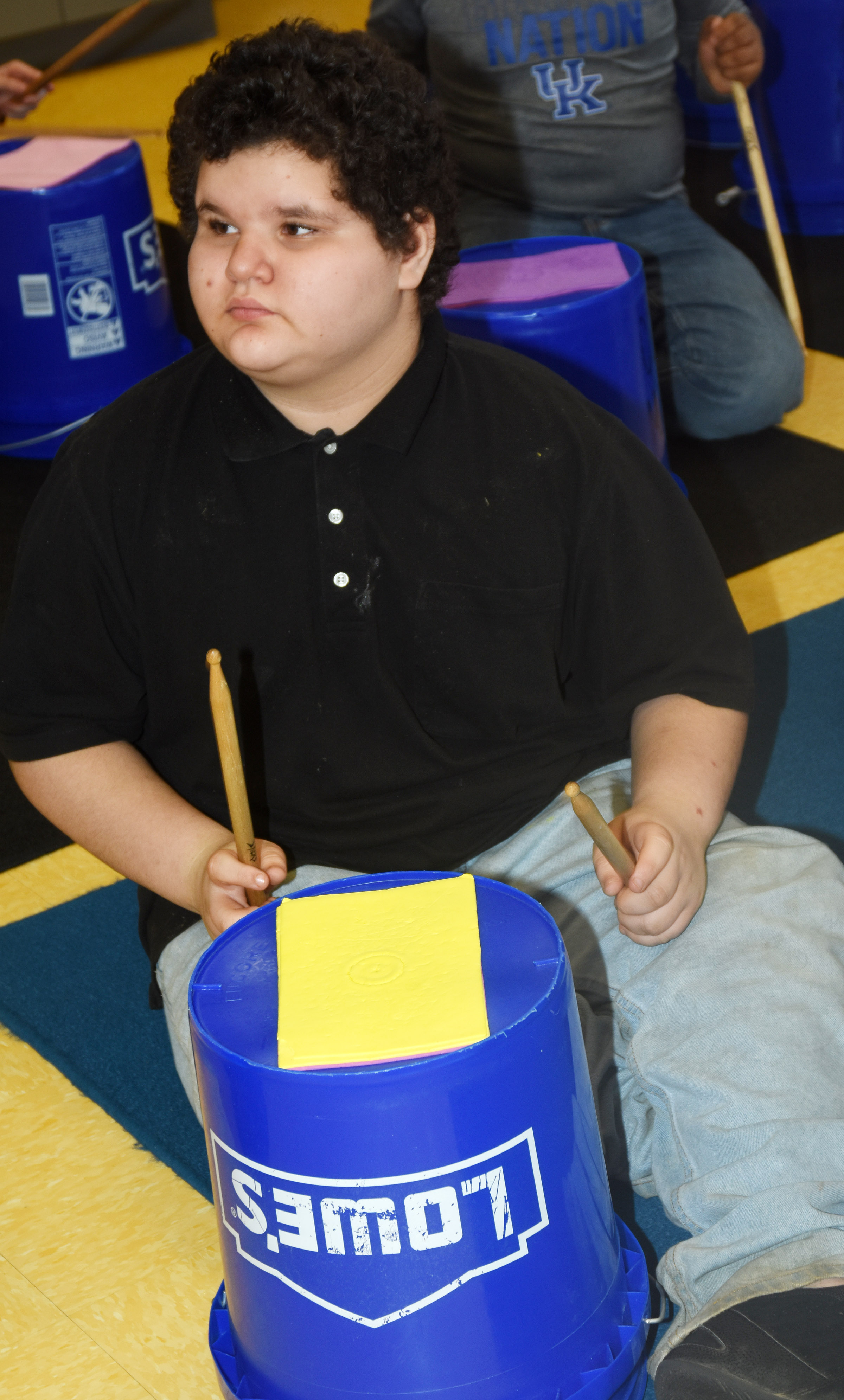 CES fifth-grader Joseph Gutierrez plays the bucket drums.
