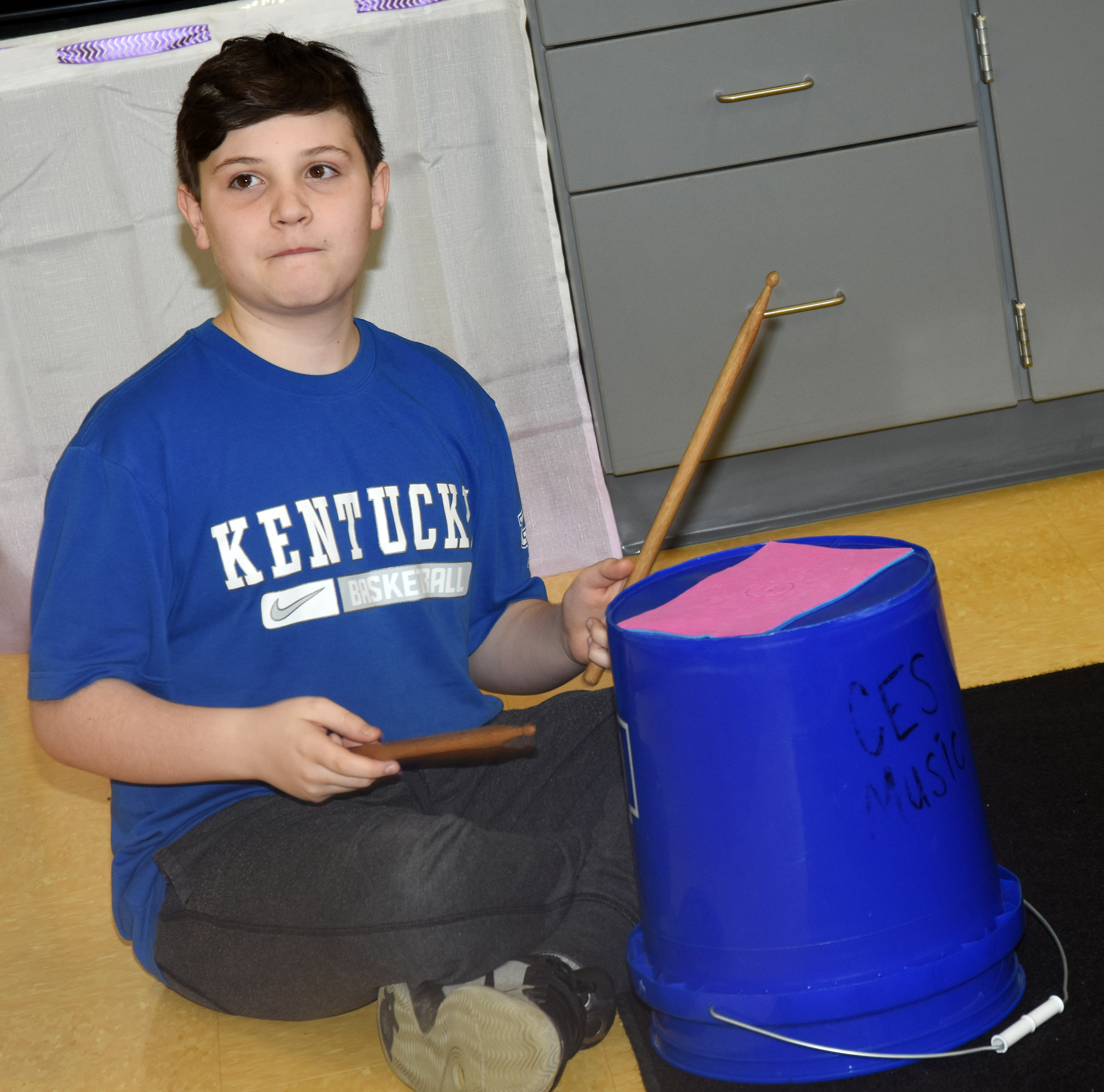 CES fifth-grader Andrew Mardis plays the bucket drums.