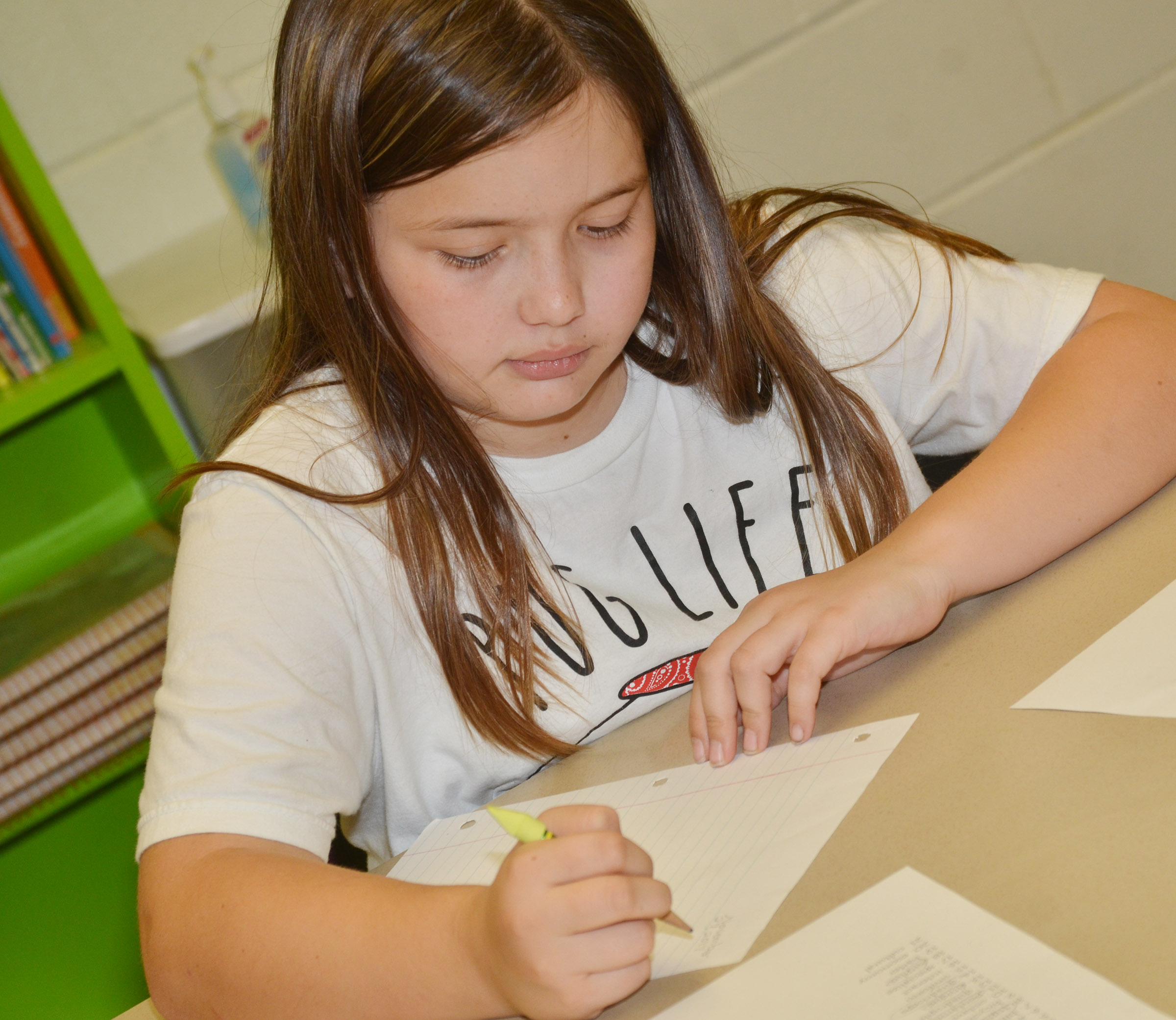 CES fifth-grader Kate Billeter practices the parts of a letter by writing a letter to Santa.