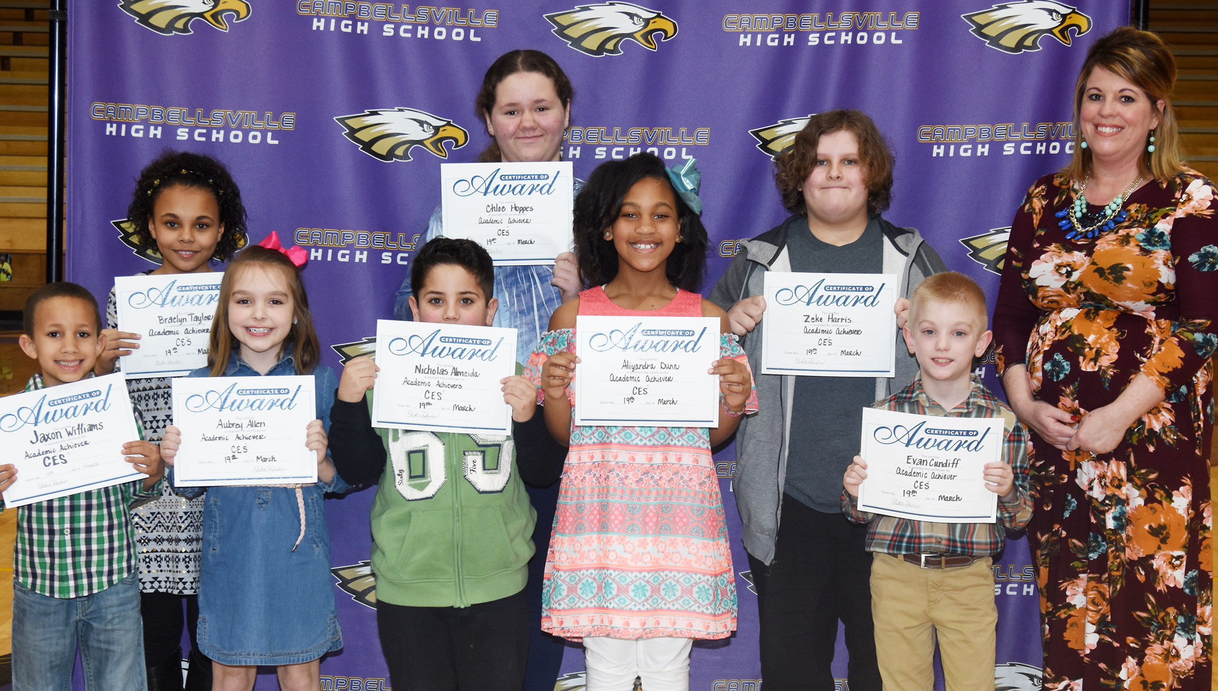 Campbellsville Elementary School recently announced its academic achievers for March. A boy and a girl from each grade level are named, and were honored at the Campbellsville Board of Education's special meeting on Monday, March 19. From left, front, are kindergartener Jaxon Williams, first-grader Aubrey Allen, second-graders Nicholas Almeida and Aliy Dunn, third-grader Evan Cundiff and CES Principal Elisha Rhodes. Back, third-grader Braelyn Taylor and fifth-graders Chloe Hoppes and Zeke Harris. Absent from the photo are kindergartener Fallyn Smith, first-grader Ayden Andrew and fourth-graders Gracie Pendleton and Devin Underwood.