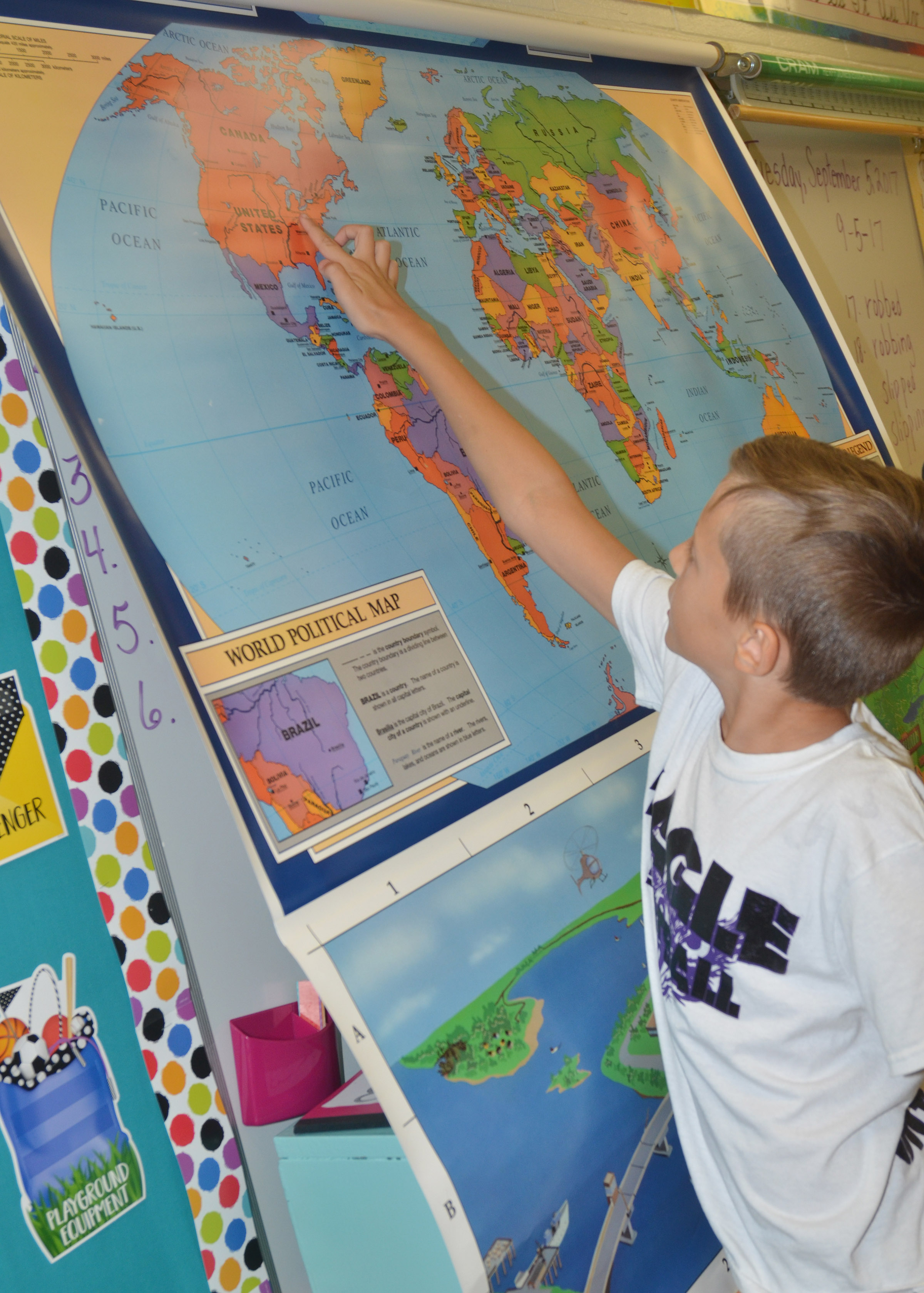 CES fourth-grader Bradley Paris finds where Campbellsville is located on a world map.