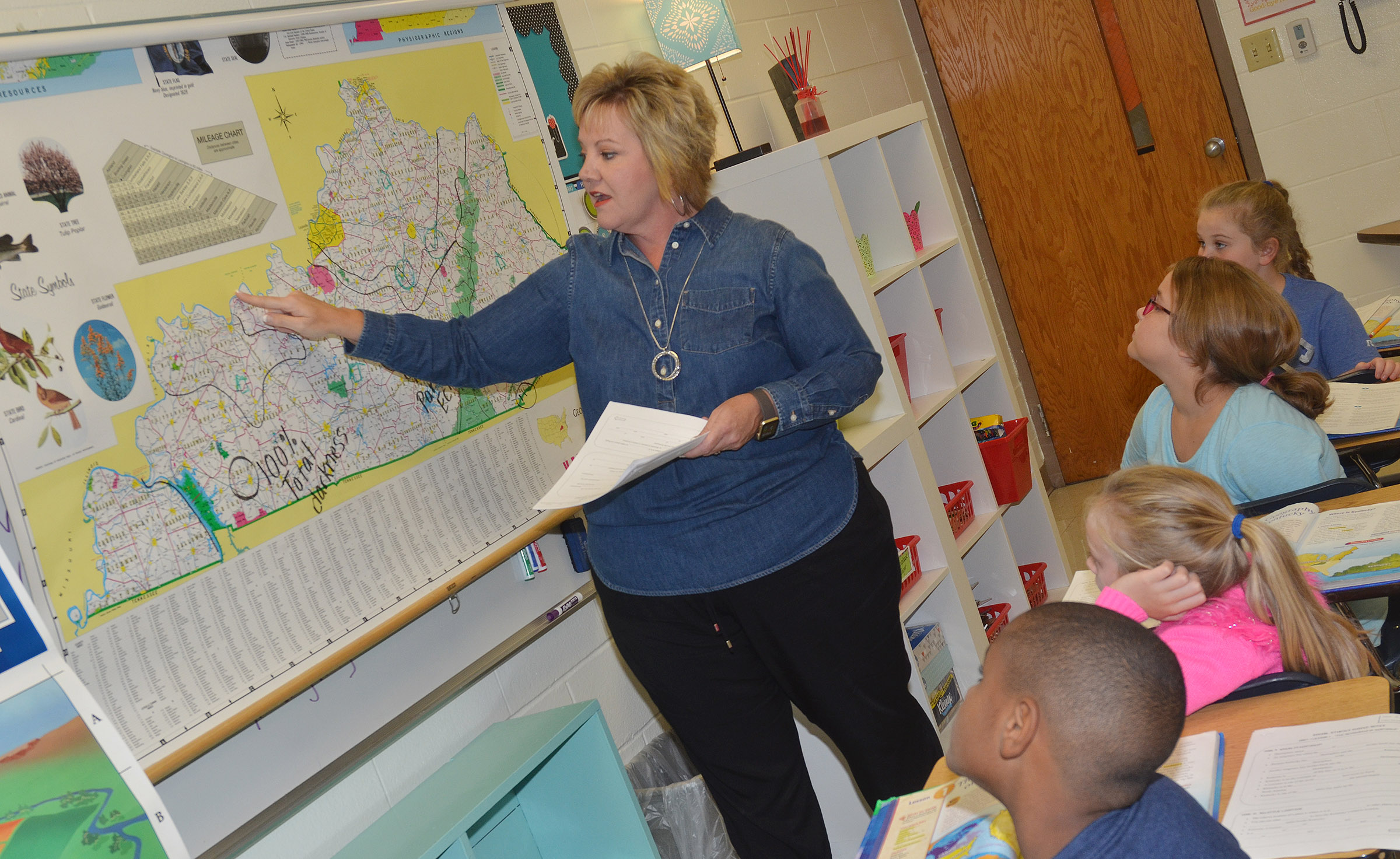 CES fourth-grade teacher Kaye Agathen talks about how a river forms the northern Kentucky border.