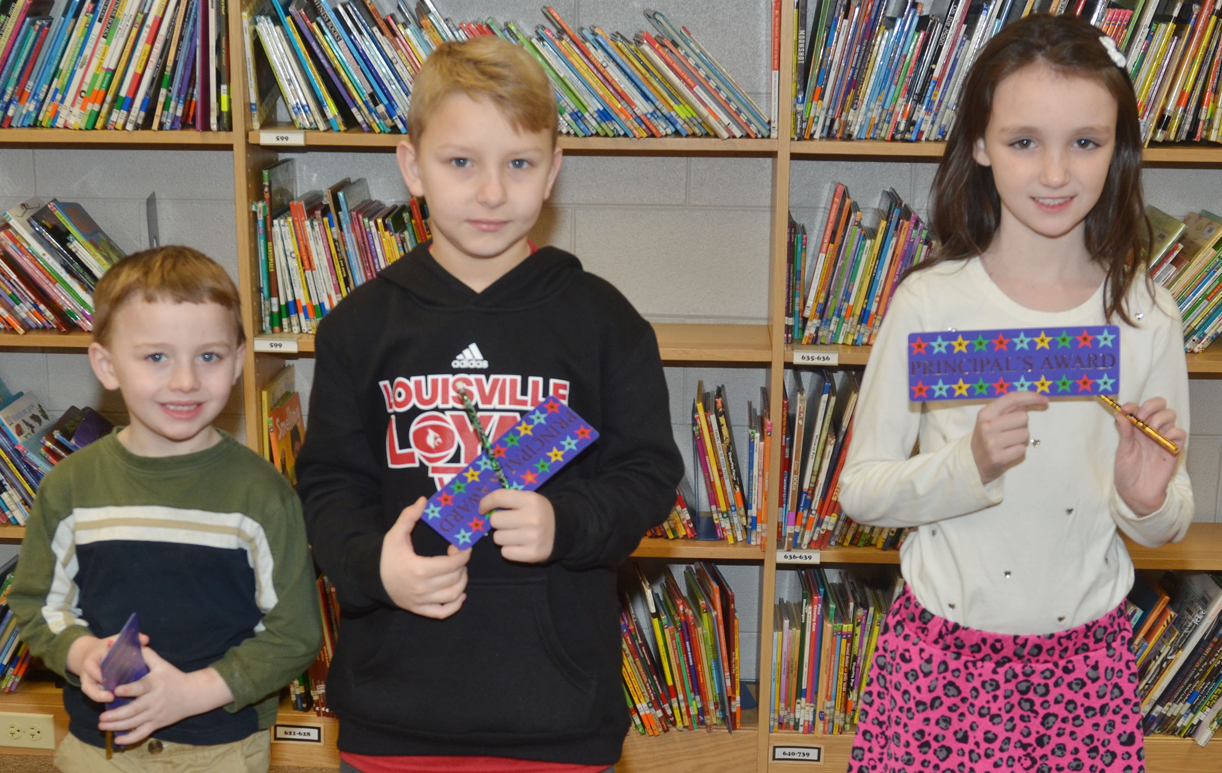 From left are kindergartener Ronnie Allen, second-grader Mason Davis and third-grader Paige Ritchie. Absent from the photo is first-grader Shlyan Dunn.