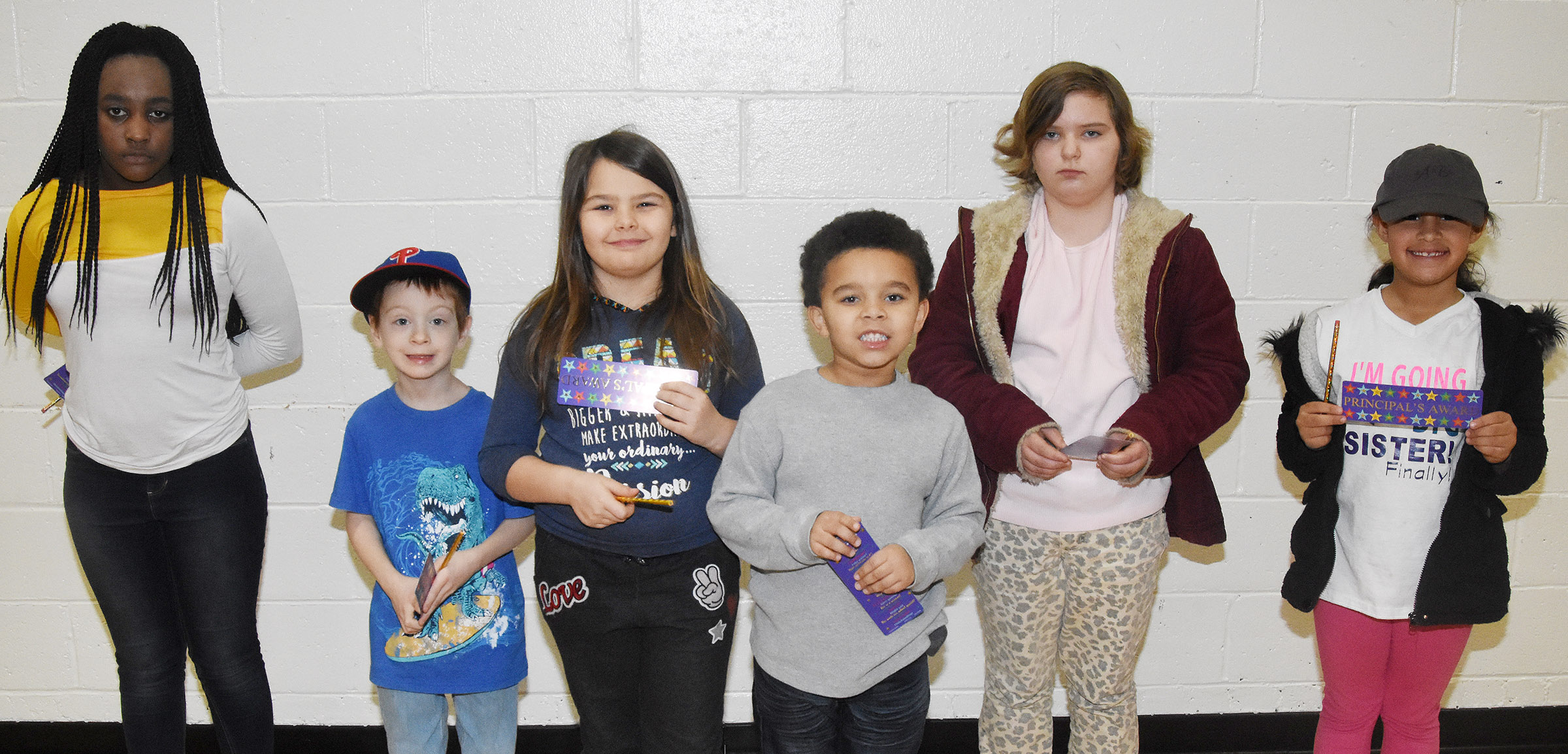From left are fifth-grader Jazzmin Coulter, first-grader Carson Montes, third-grader Dorothy Shively, kindergartener Tyrek Moore, fourth-grader Mary James and second-grader Amani Bridgewater.
