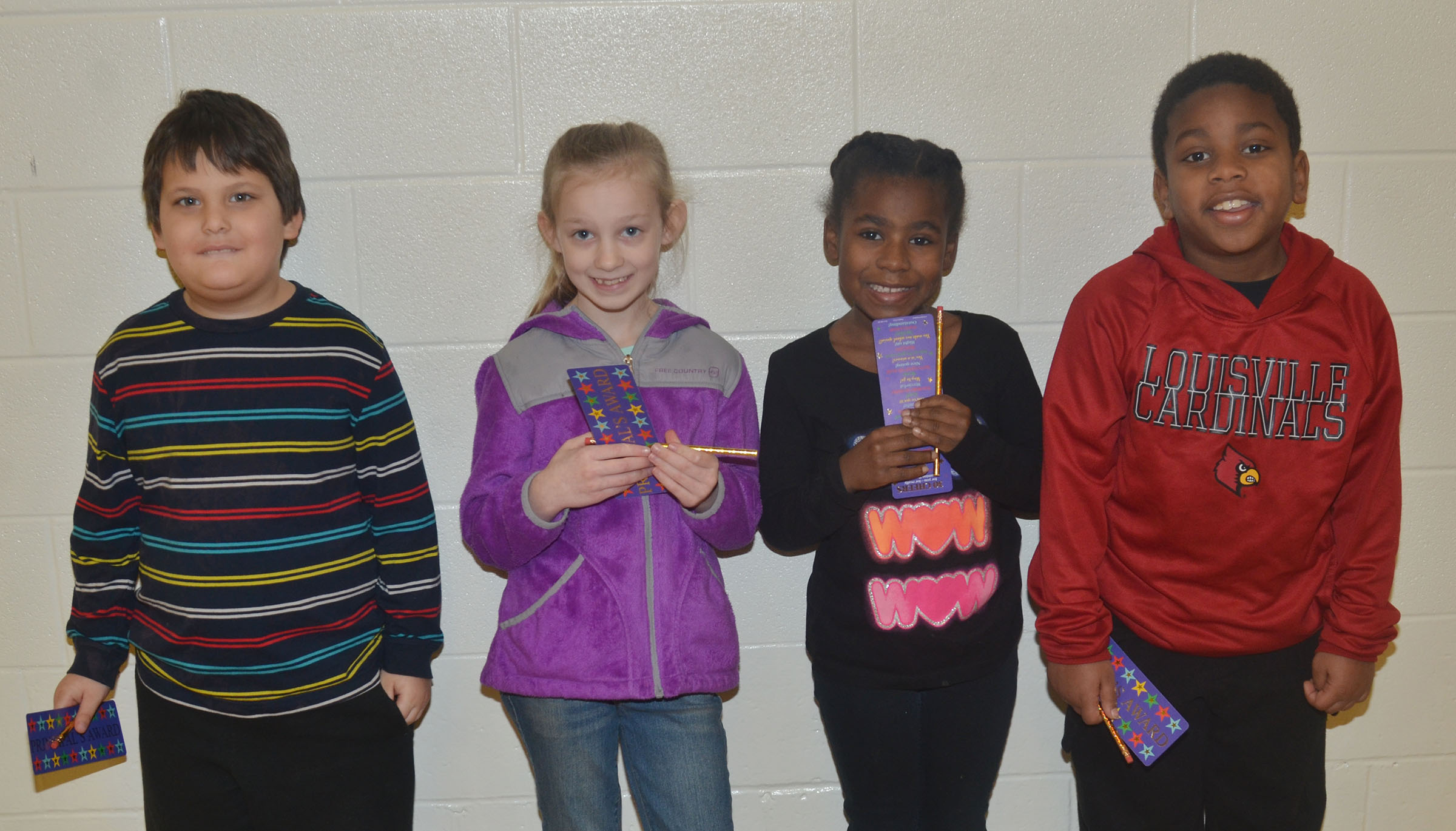 From left are kindergartener Cloud Malone, third-grader Kendall Bright, first-grader Destini Gholston and second-grader Elijah Spurling.