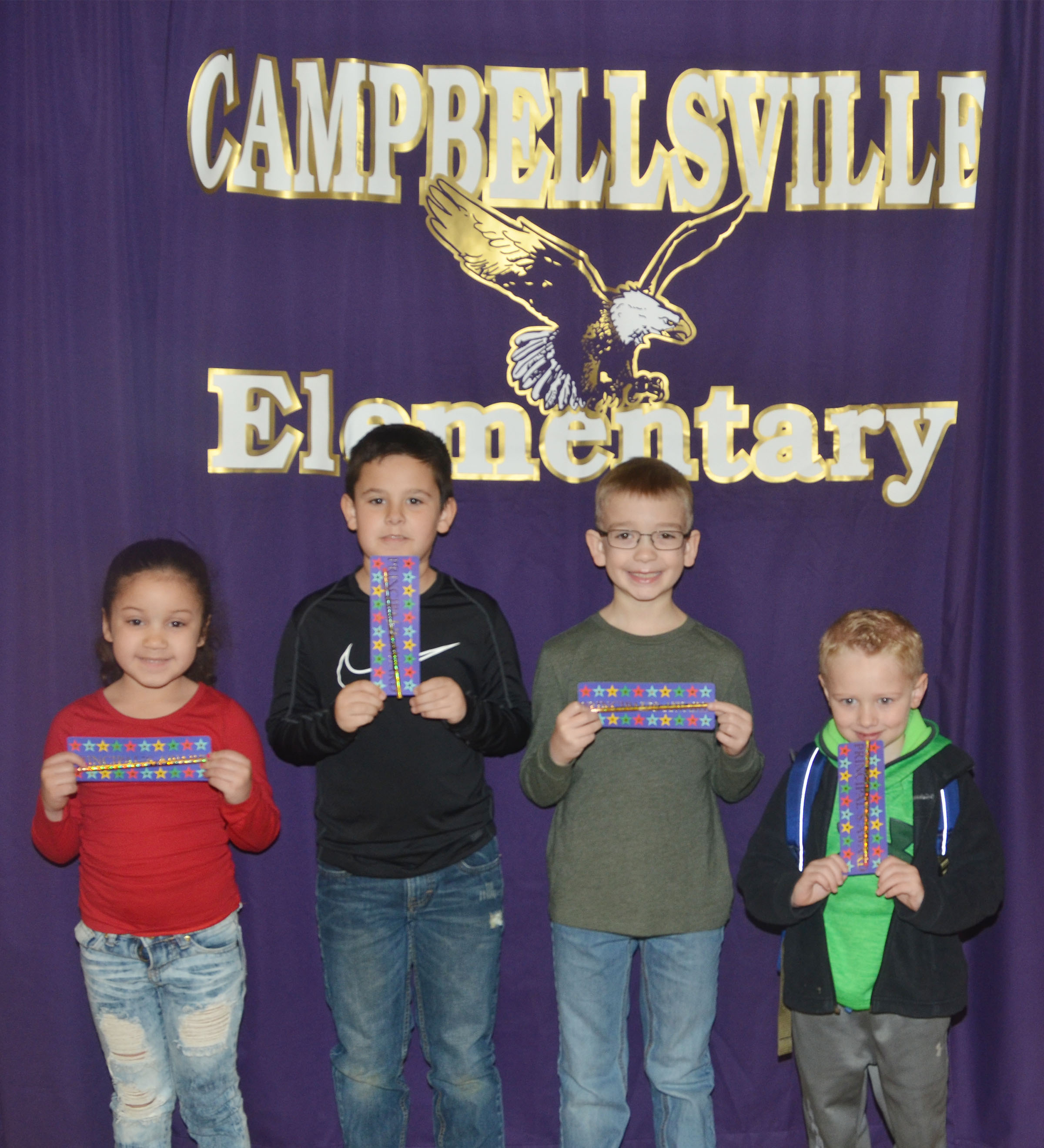 From left are first-grader Nadia Taylor, second-grader Damien Clark, third-grader Cameron Estes and kindergartener Jackson Wright.