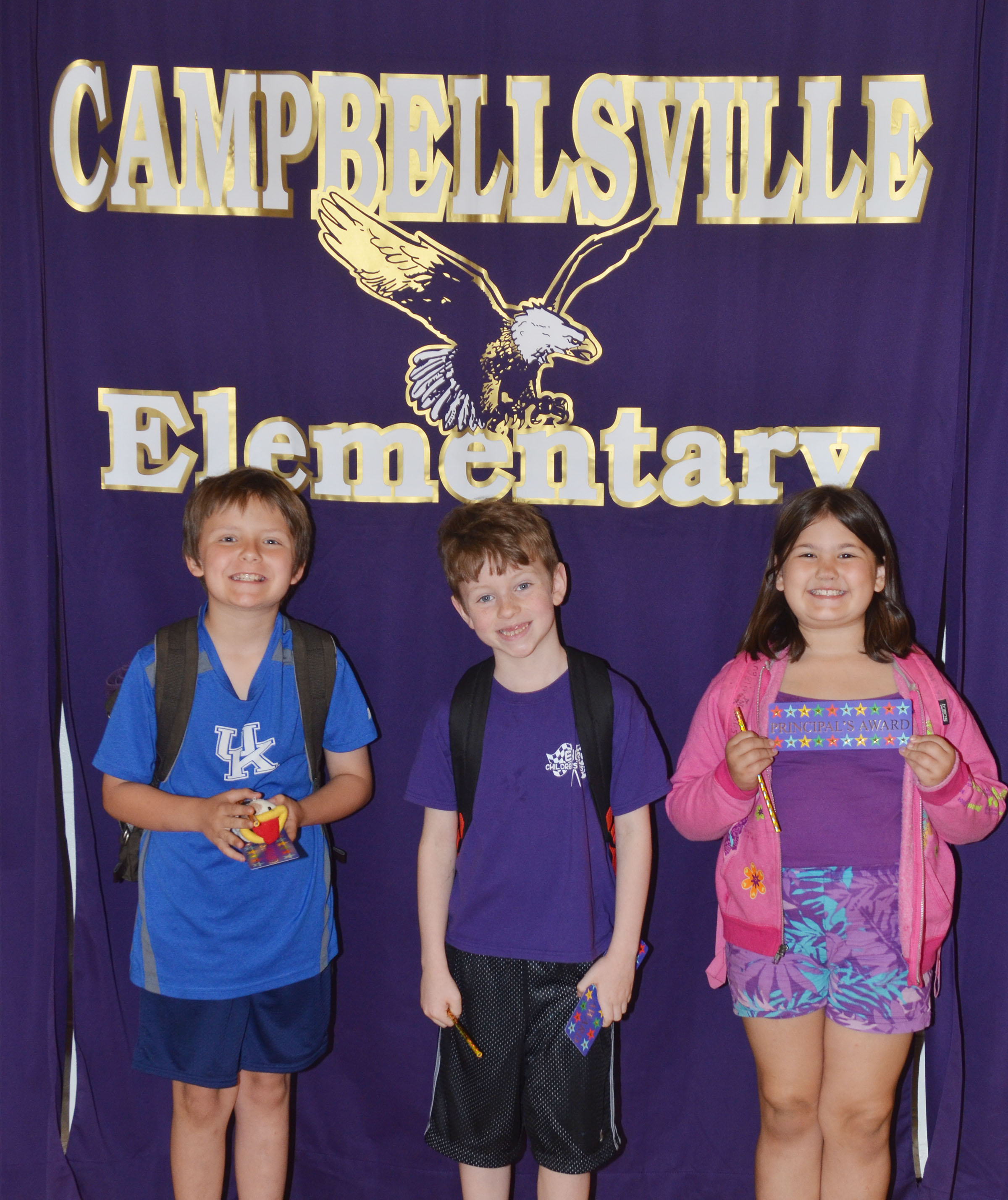 From left are third-grader Daniel Shively, first-grader Jayden Cox and second-grader Marissa Sumners. Absent from the photo is kindergartener Joey Bledsoe.