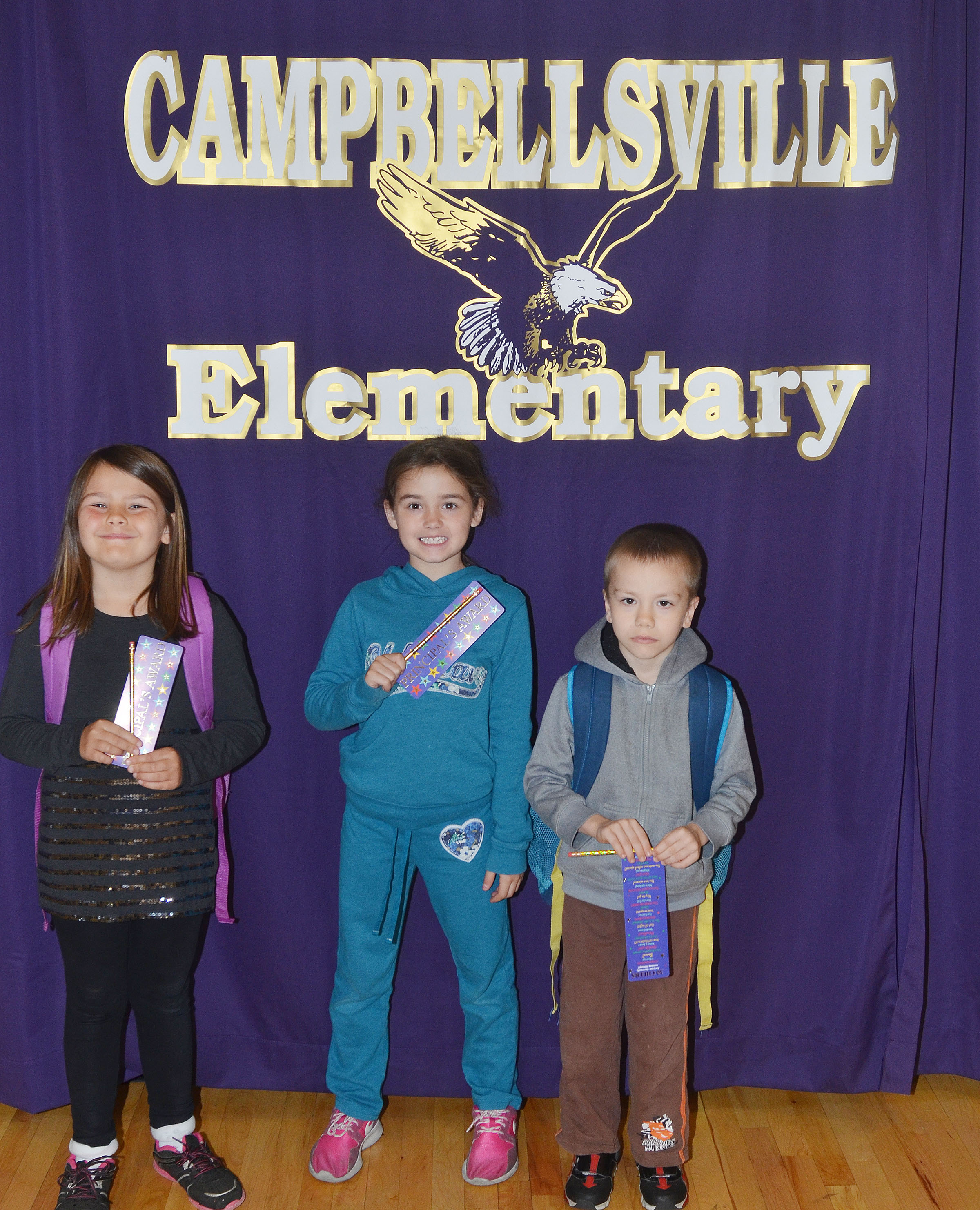 From left are second-grader Dorothy Shively, third-grader Alexis Wolford and kindergartener Alex Eggers. Absent from the photo is first-grader Anna Keith.