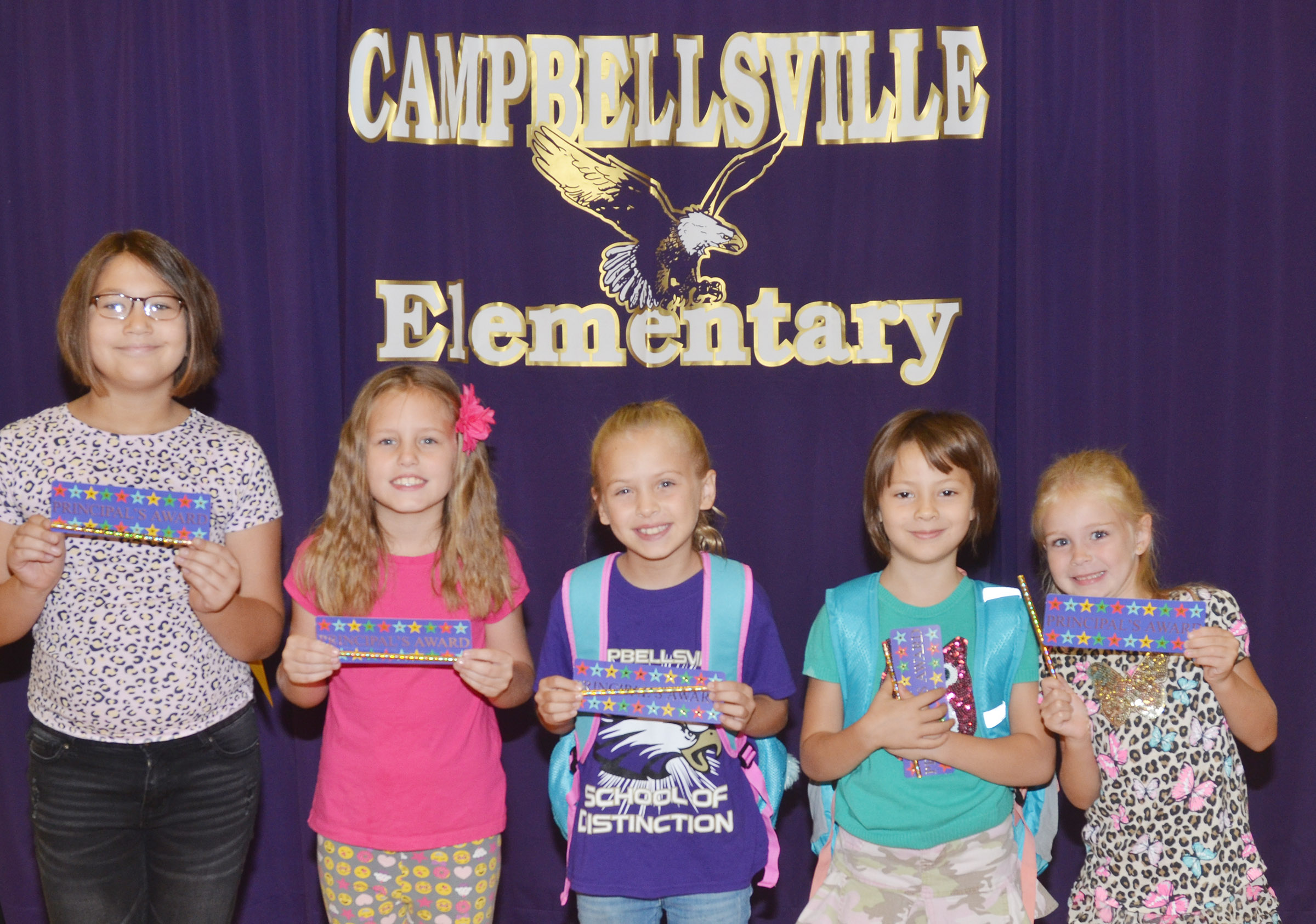 From left are fifth-grader Kylee Sowders, fourth-grader Madisyn Bradfield, third-grader Ava Ellis, first-grader Veda Burgess and kindergartener Alinna Bray. Second-grader Aaron Floyd is absent from the photo.