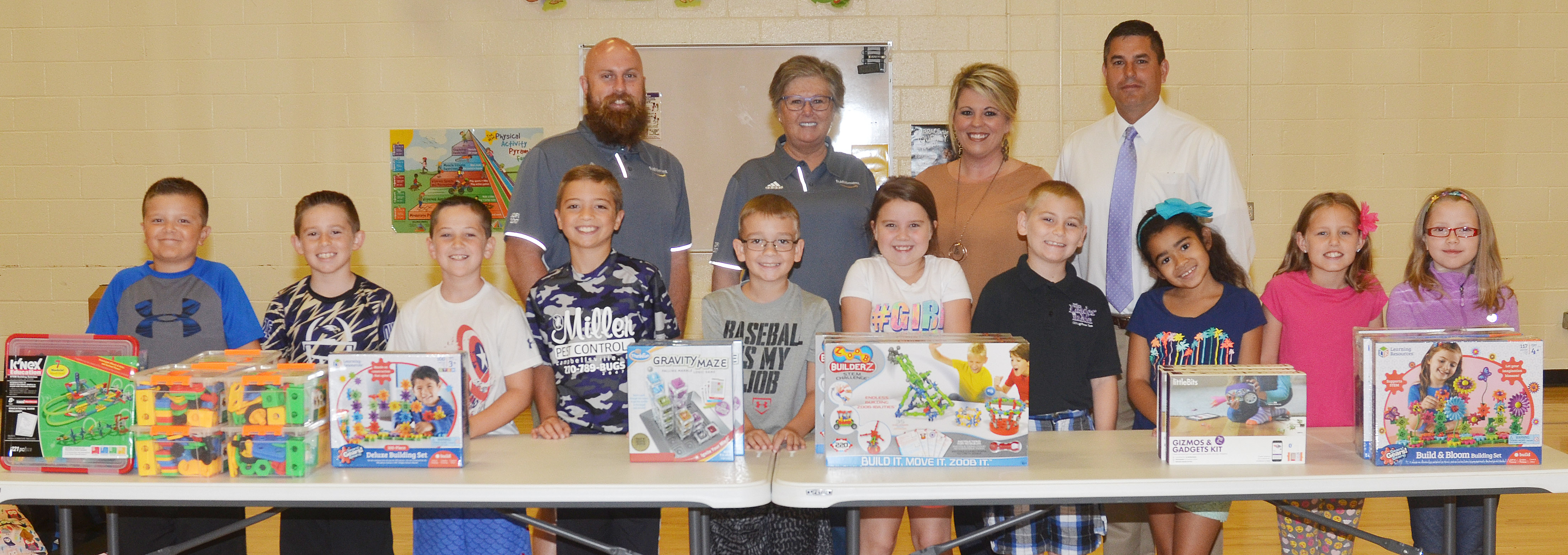 Chad Forsyth, an operations manager, and Tammy Cox, an administrative assistant at Amazon, recently came to CES to donate some STEM toys during a special assembly. Pictured are, from left, front, CES third-graders Cayton Lawhorn, Lanigan Price and Luke Adkins, fourth-graders Carson Mills, Cameron Estes and Maylee Wilds, third-graders Joseph Greer and Sophia Santos and fourth-graders Madisyn Bradfield and Gracie Pendleton. Back, Forsyth, Cox, CES Principal Elisha Rhodes and Campbellsville Independent Schools Superintendent Kirby Smith.