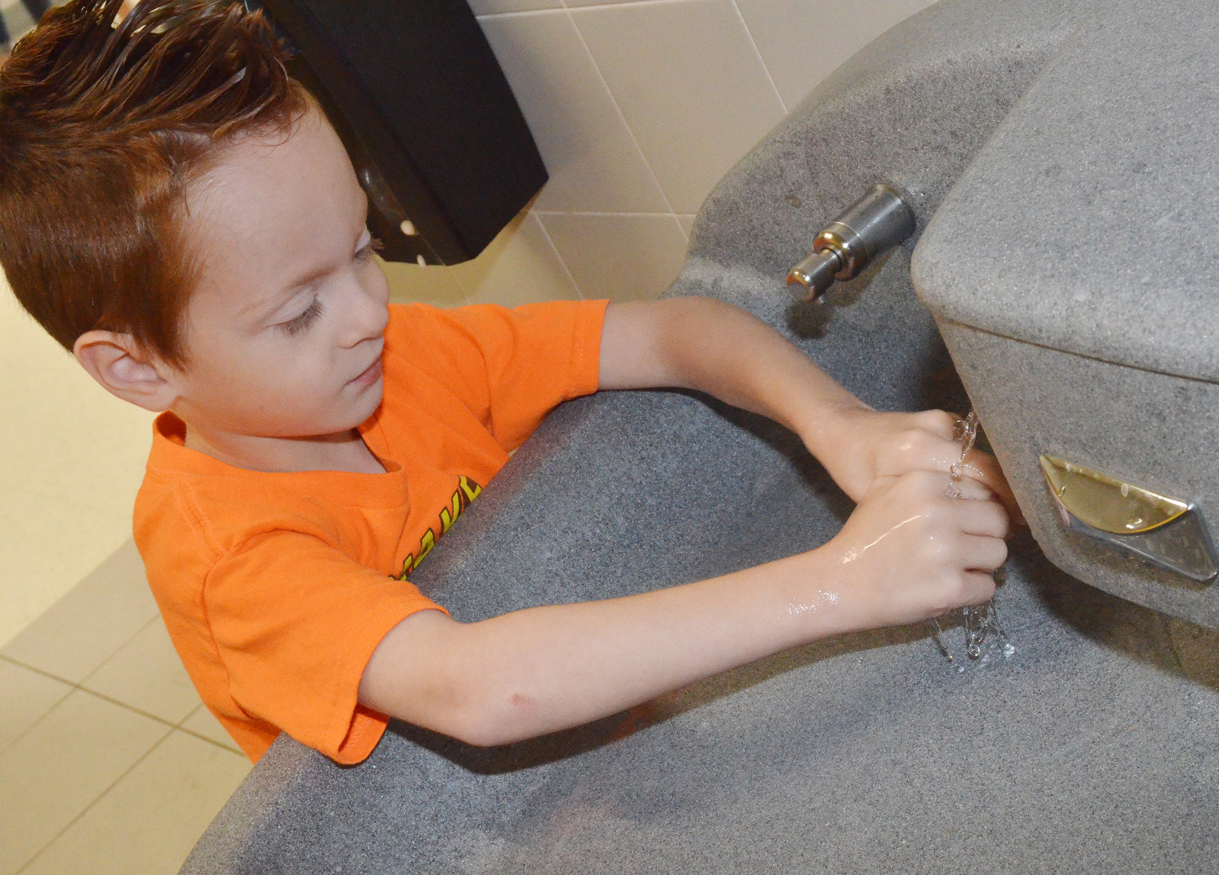 CES first-grader Carson Montes practices washing his hands.