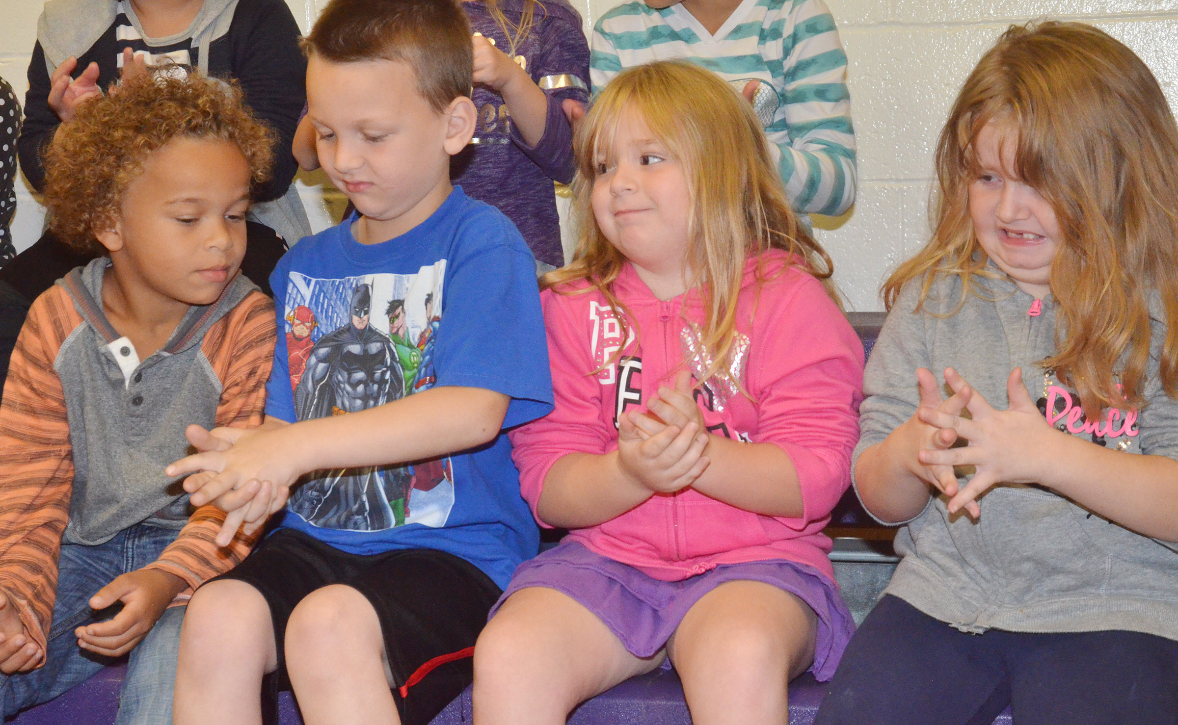 "CES first-graders, from left, Dyra Welch, Justice Nelson, Briley Sapp and Laurna McKenzie aren't quite sure about the ""germs"" that have been placed on their hands."