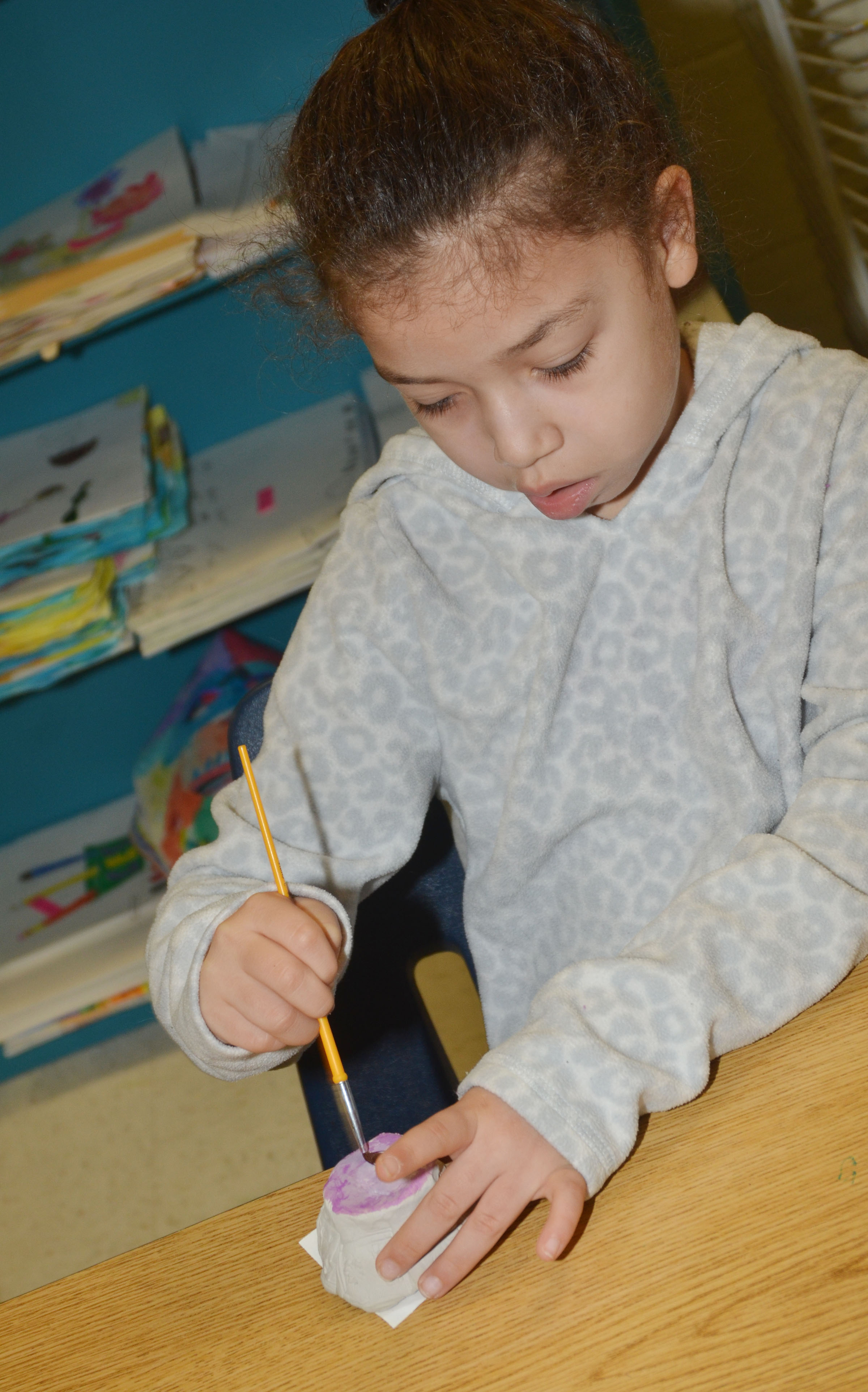 CES first-grader Ammarissa Nunez paints her pot.