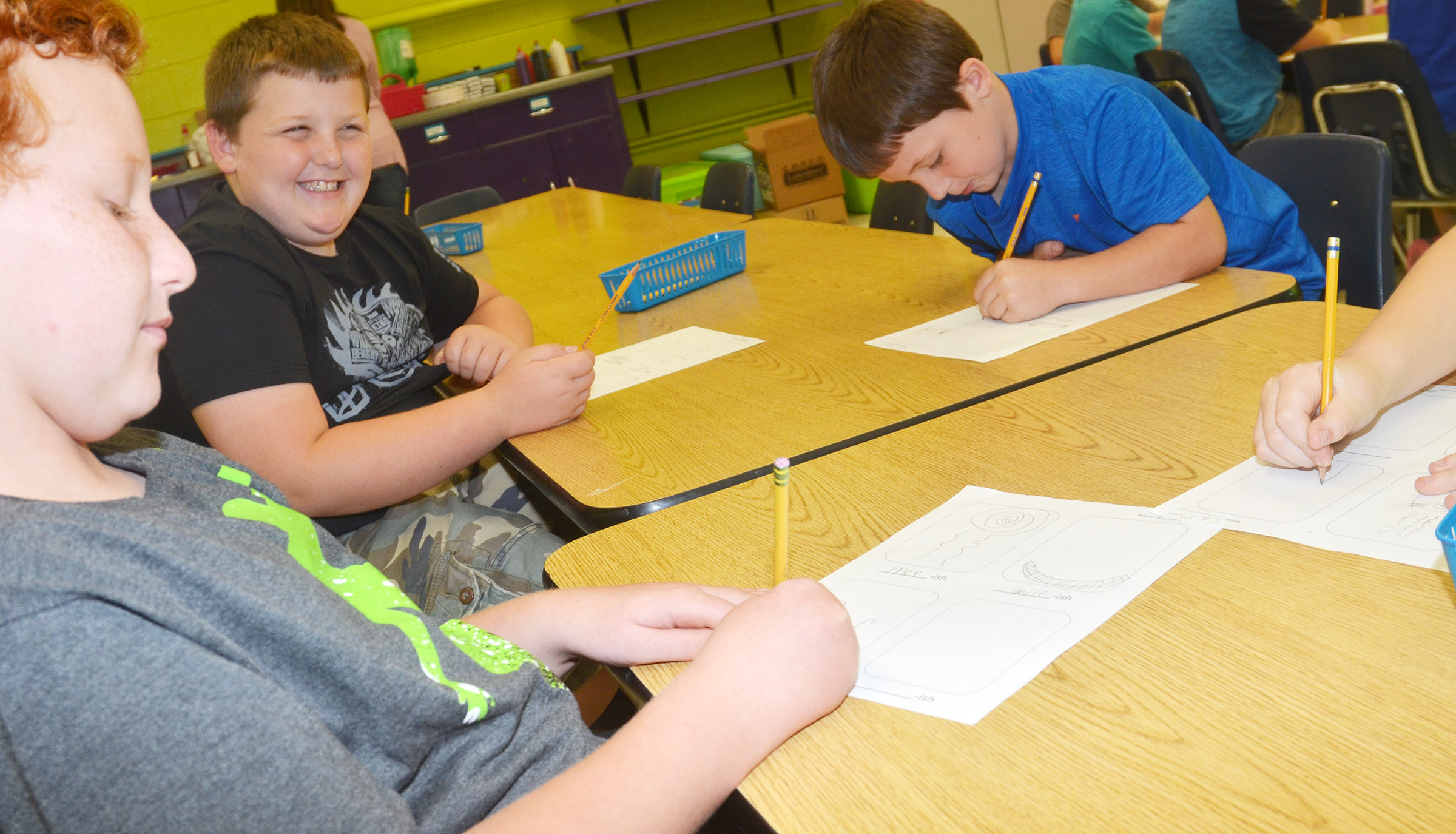 "From left, CES third-graders Reece Swafford, Braxton Tucker and Codey Parks draw their ""-ish"" drawings."