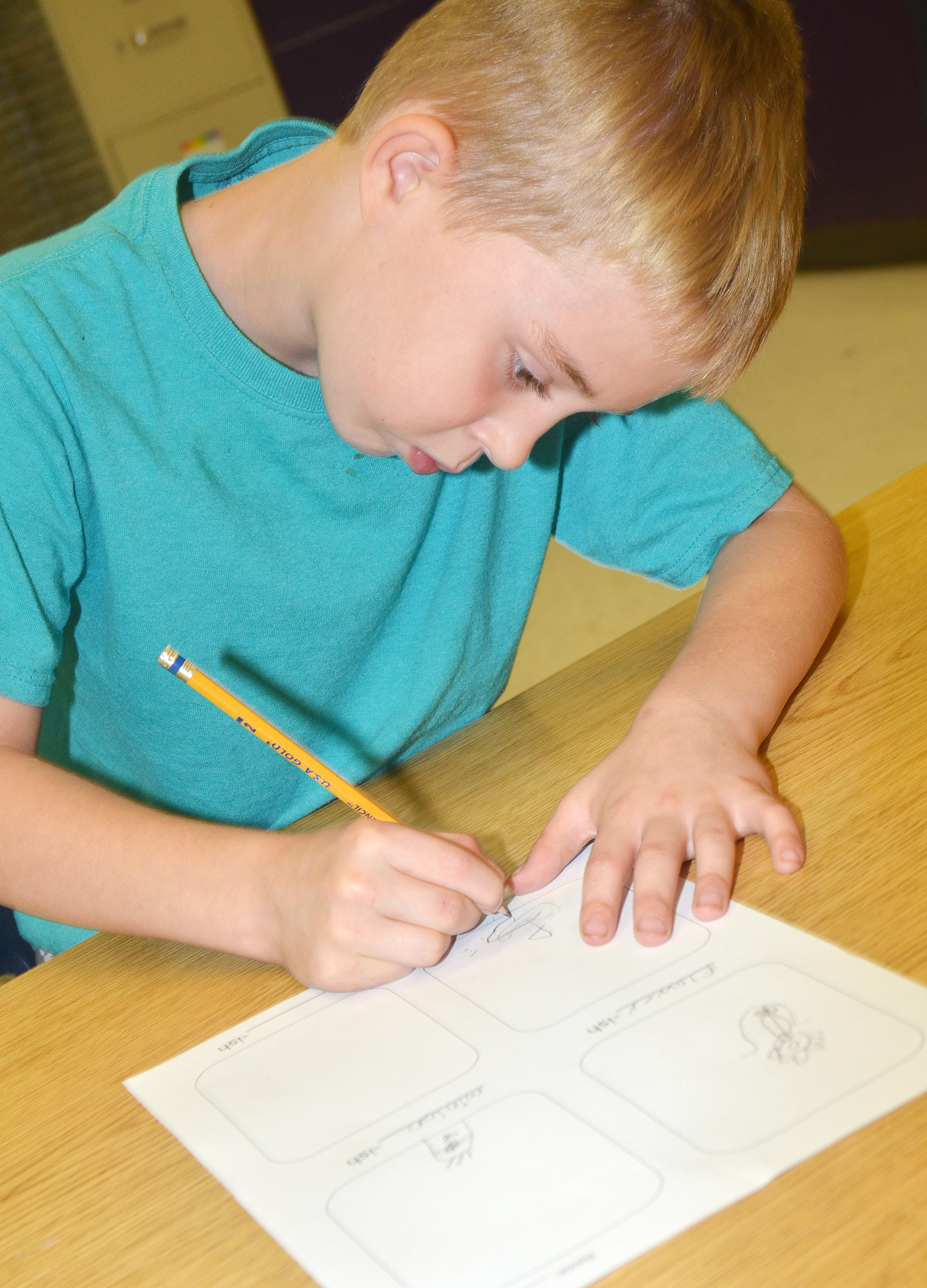 "CES third-grader Devyn Tingle draws his ""-ish"" drawings."