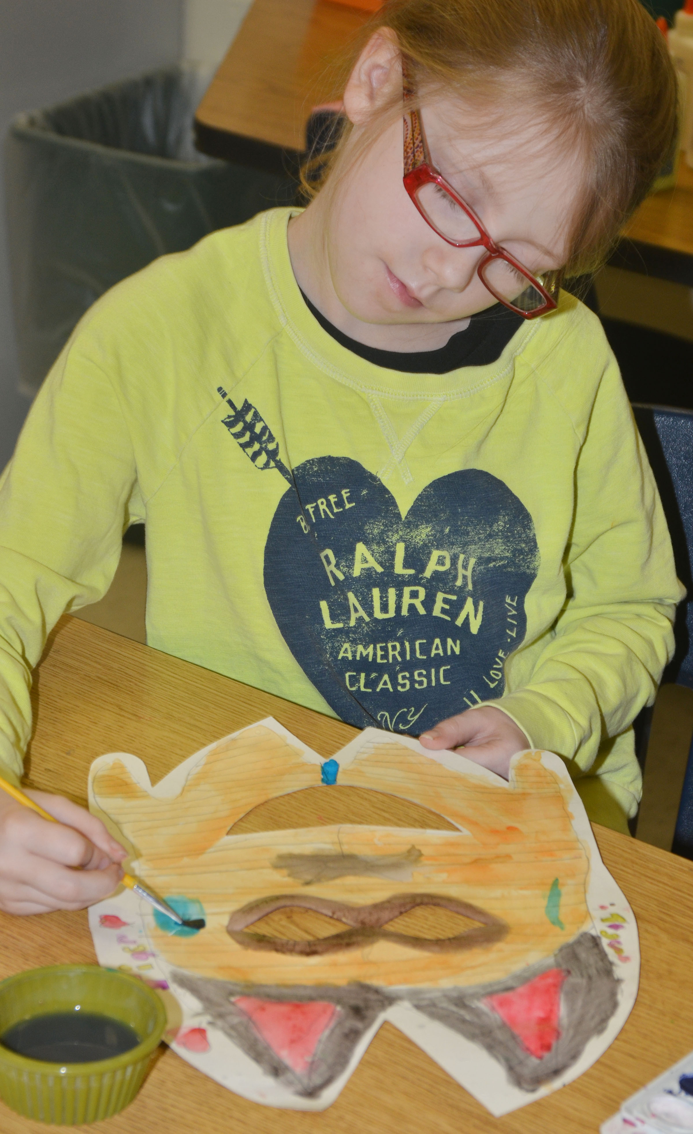 CES third-grader Gracie Pendleton paints her African masks.