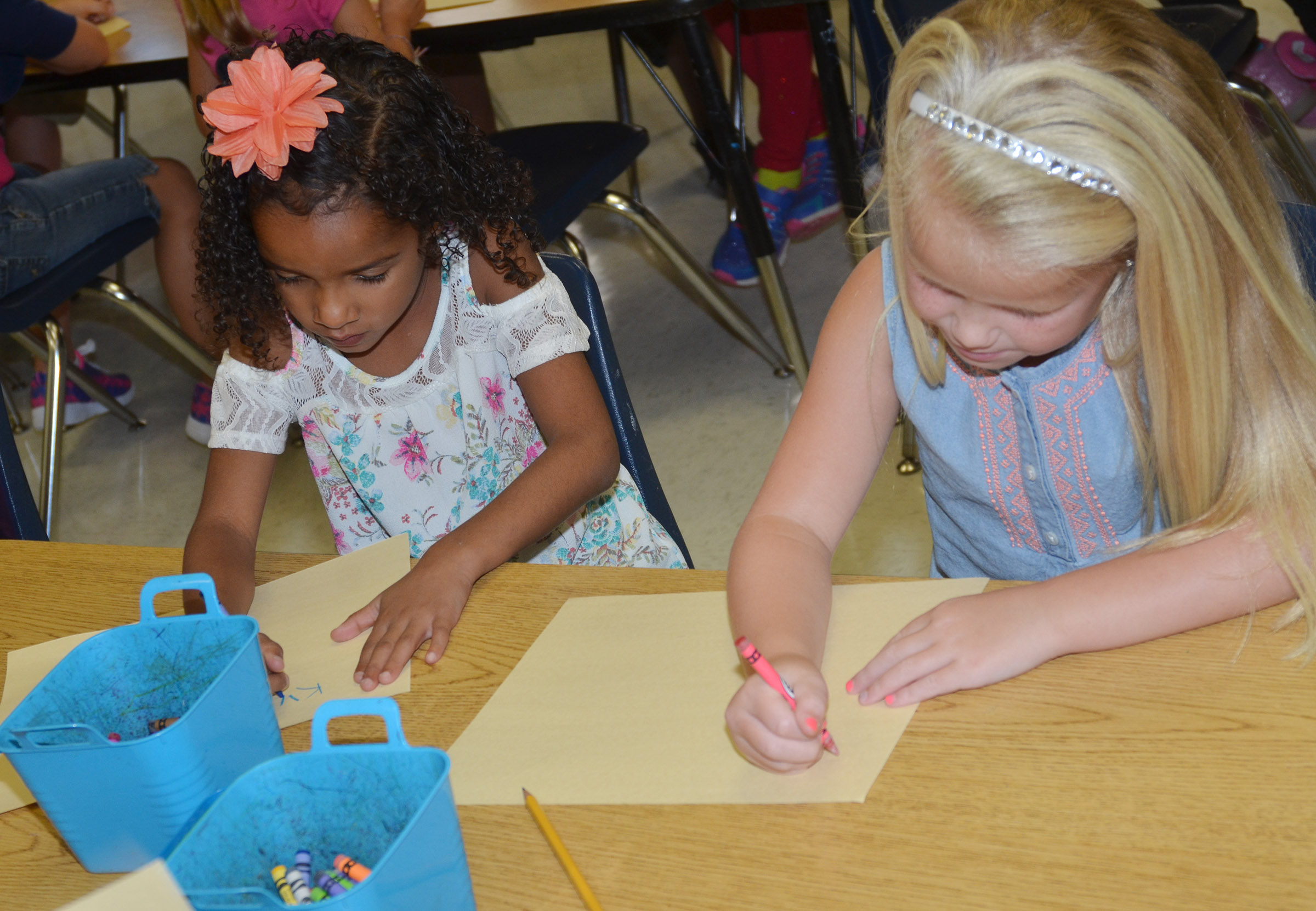"CES first-graders Kylei Thompson, at left, and Lillie Judd create their ""Beautiful Oops"" artwork."