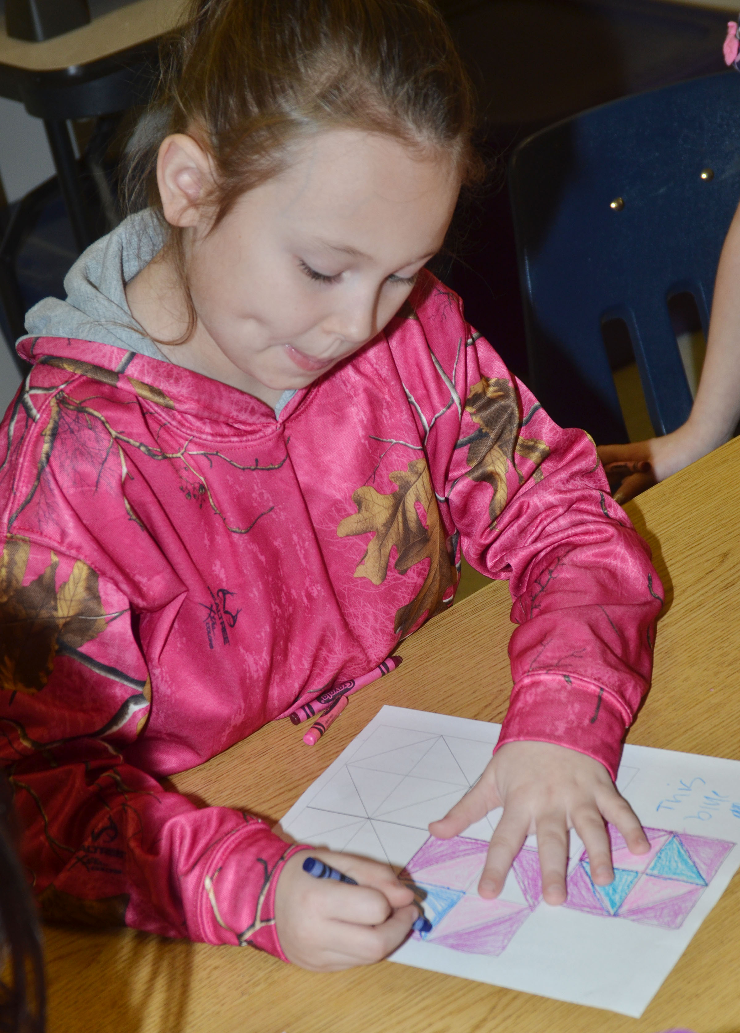 CES second-grader River McFarland colors her quilt square.
