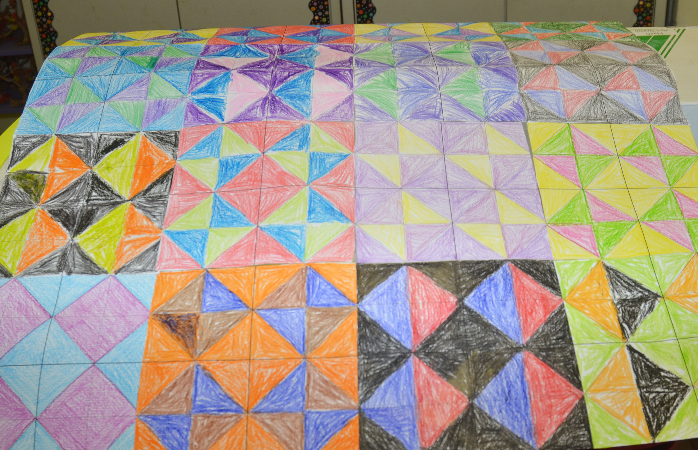 When finished, students' squares will be glued together to make a class quilt.