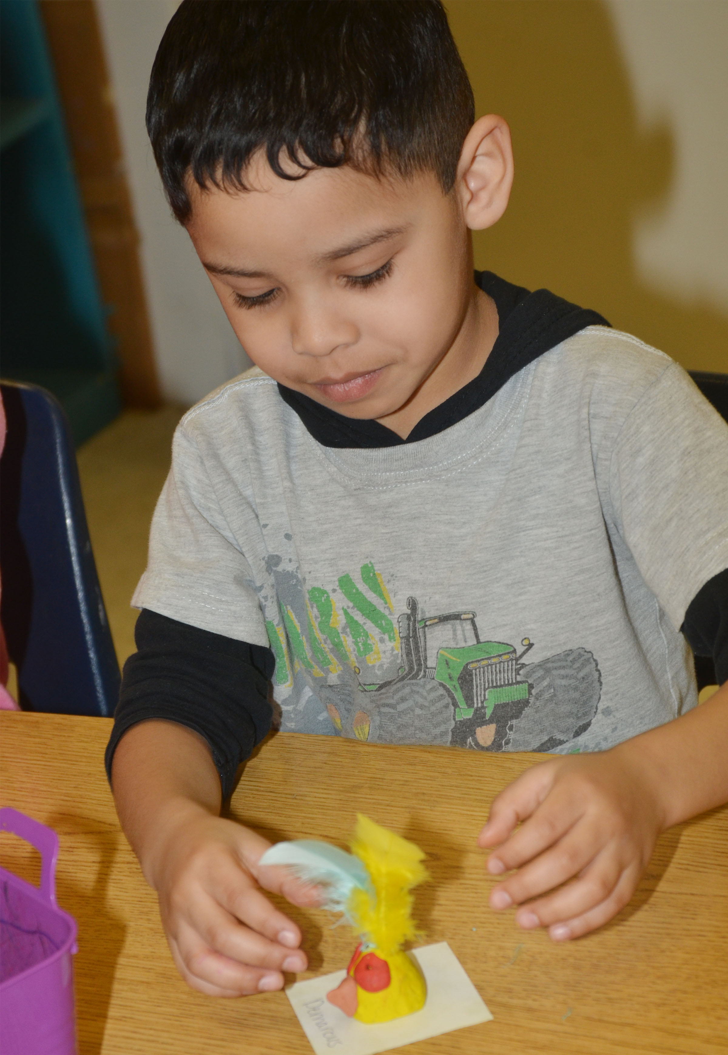CES kindergartener Demarcus Noyola puts finishing touches on his owl.