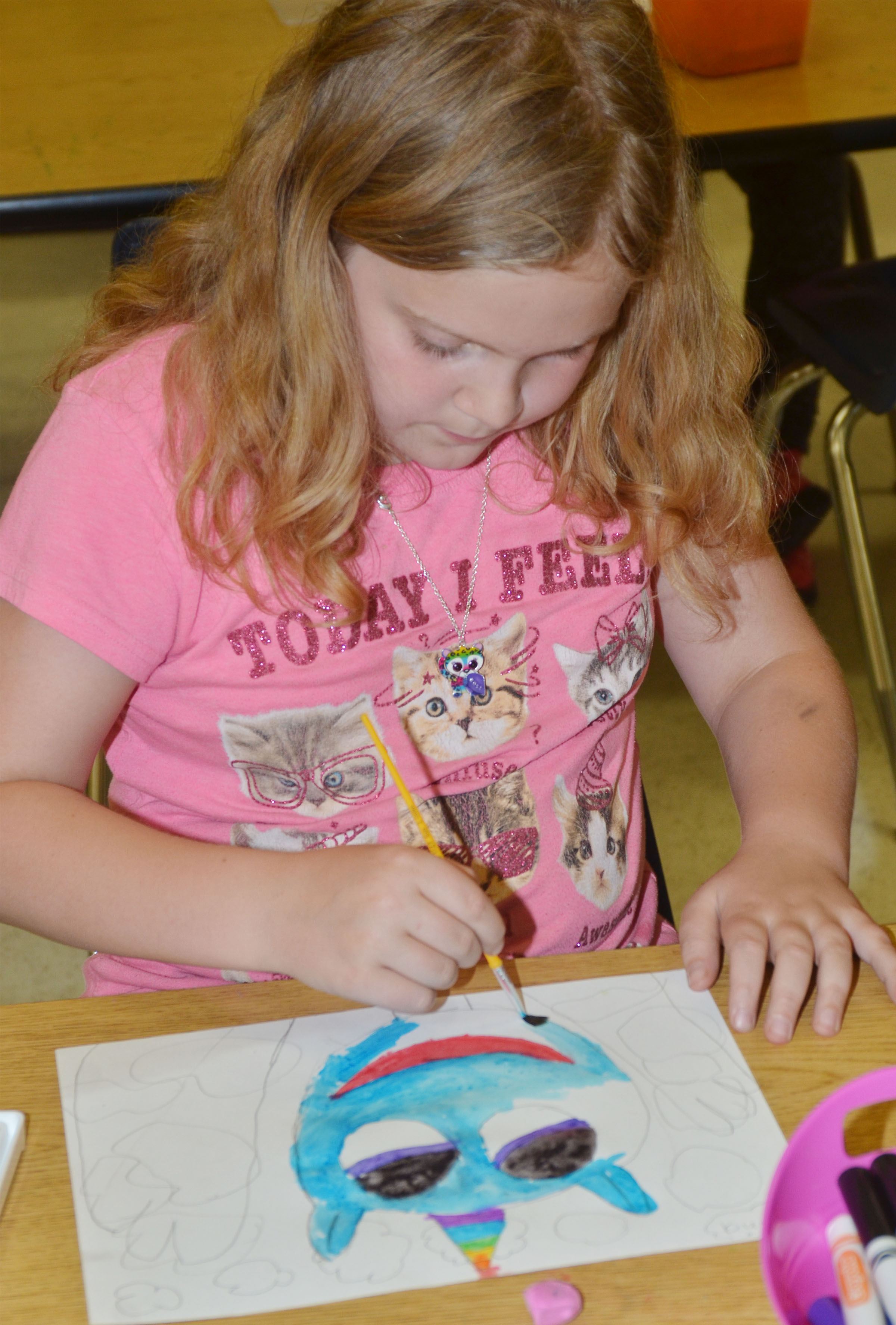CES third-grader Arianna Childers paints.