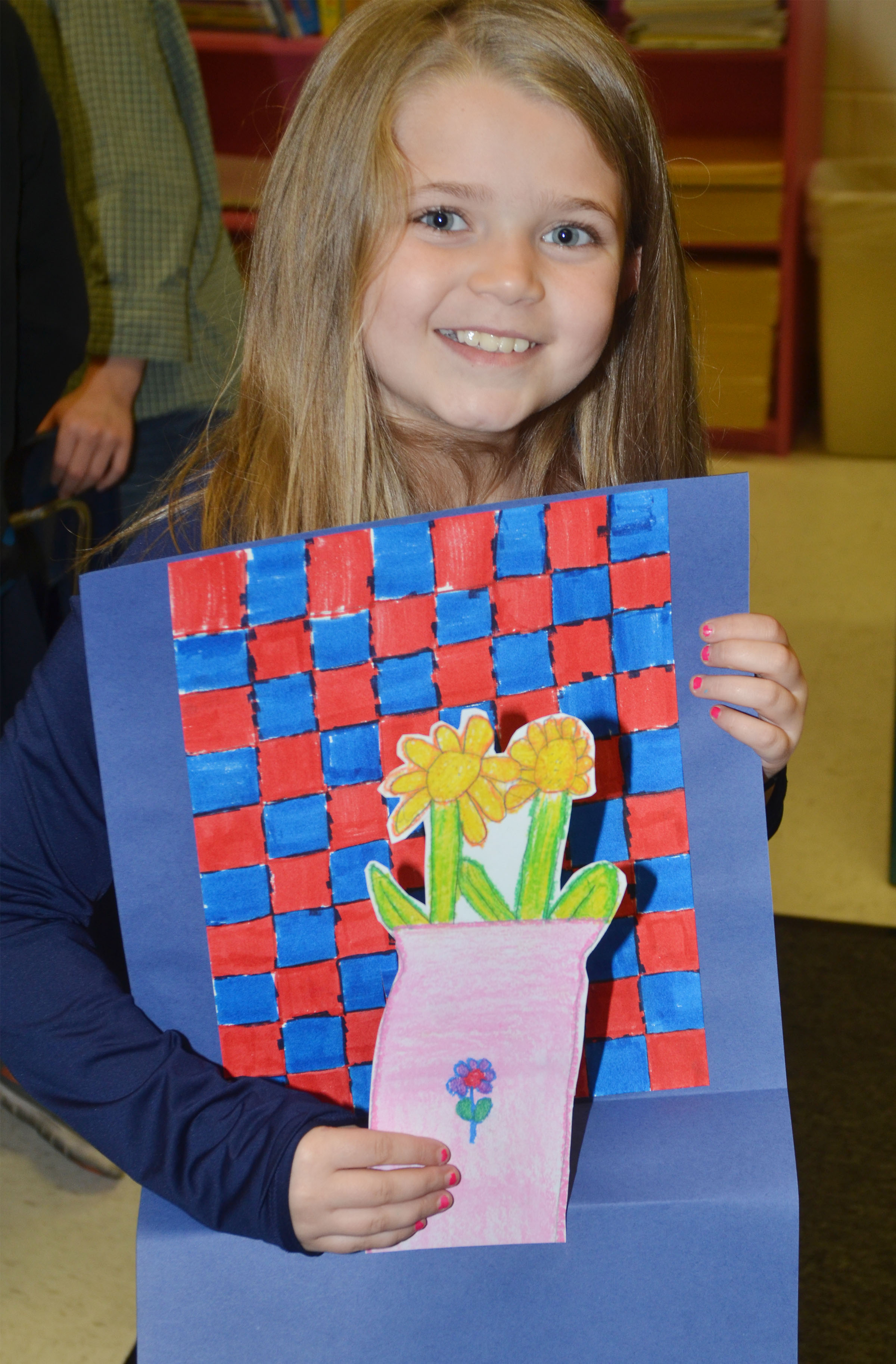 CES third-grader Chyanne Christie holds her Vincent Van Gogh-inspired flower.