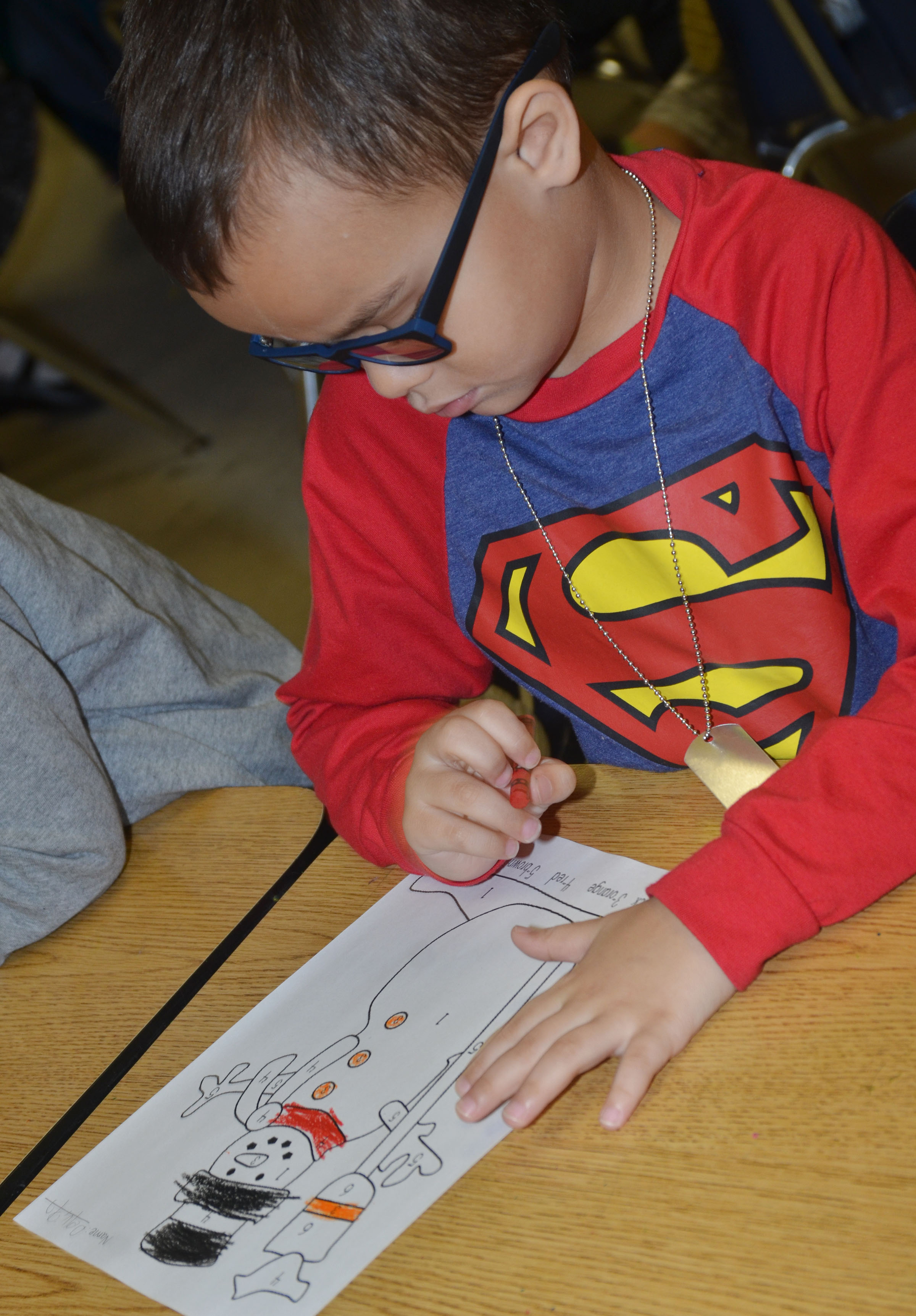 CES kindergartener Davian Taylor colors his snowman for the coloring contest.