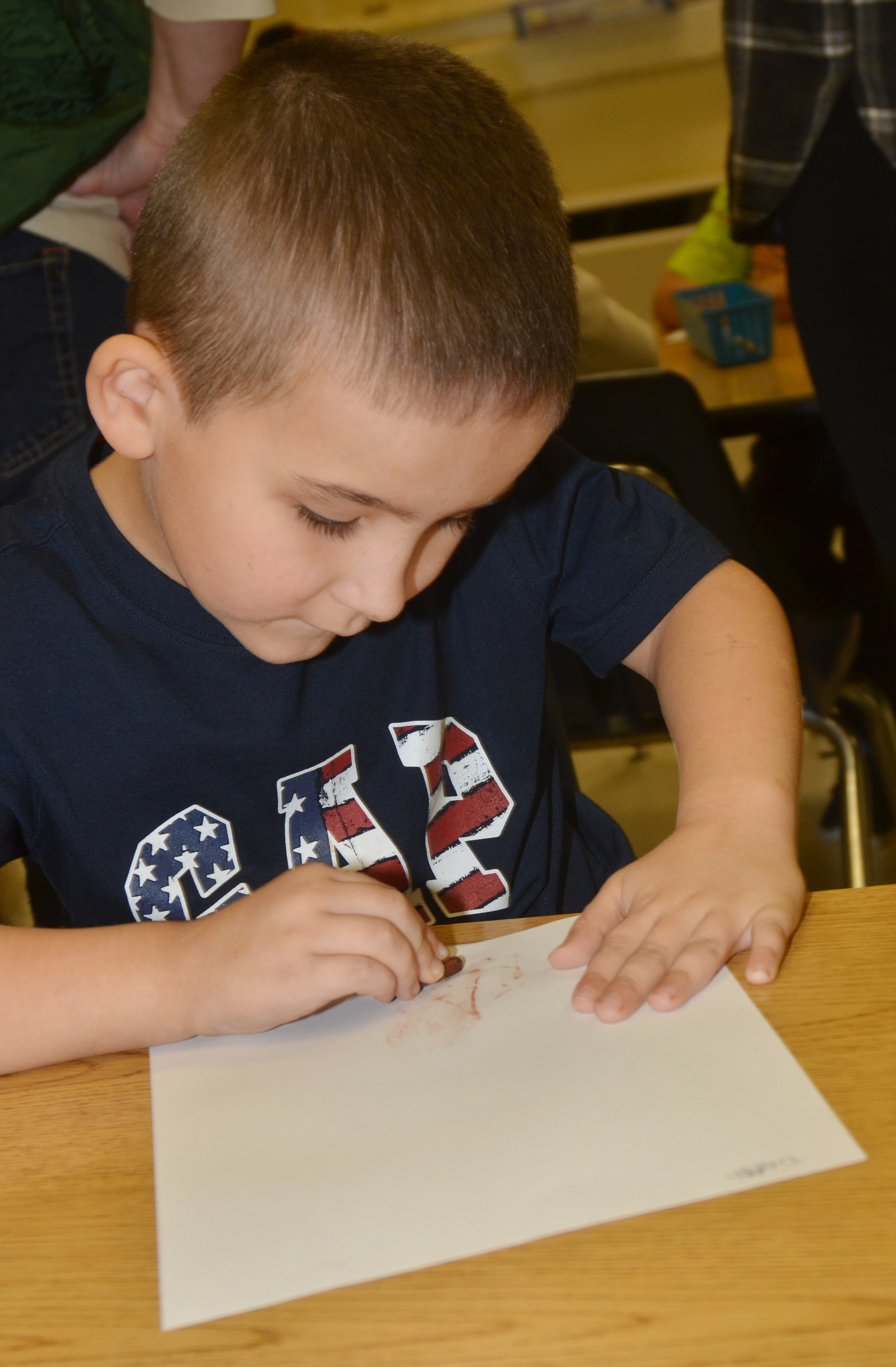 CES kindergartener Josiah Edwards rubs a pattern with his crayon.