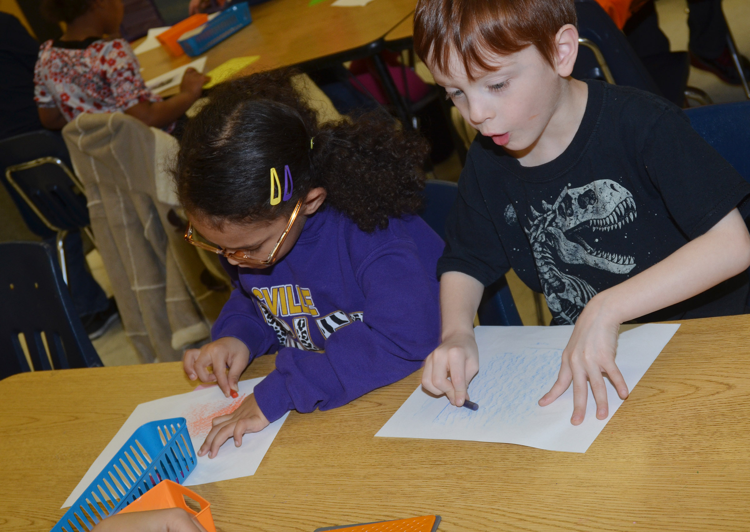 CES kindergarteners Marlee Dickens, at left, and Carson Montes rub patterns.