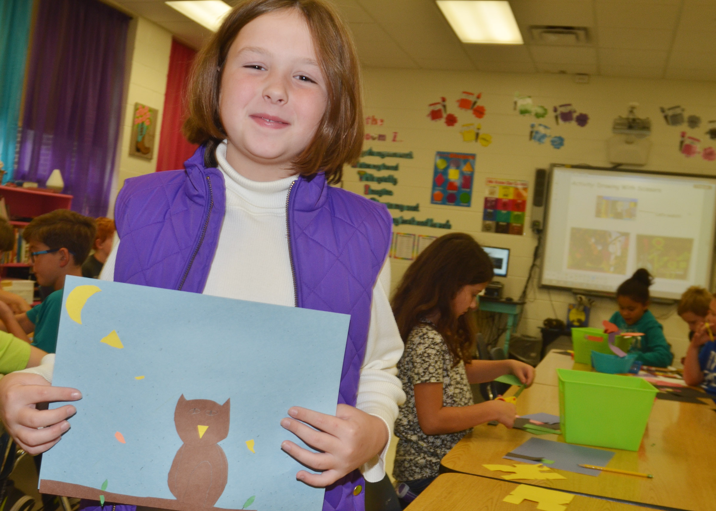 CES third-grader Evelyn Stancill holds her finished drawing.