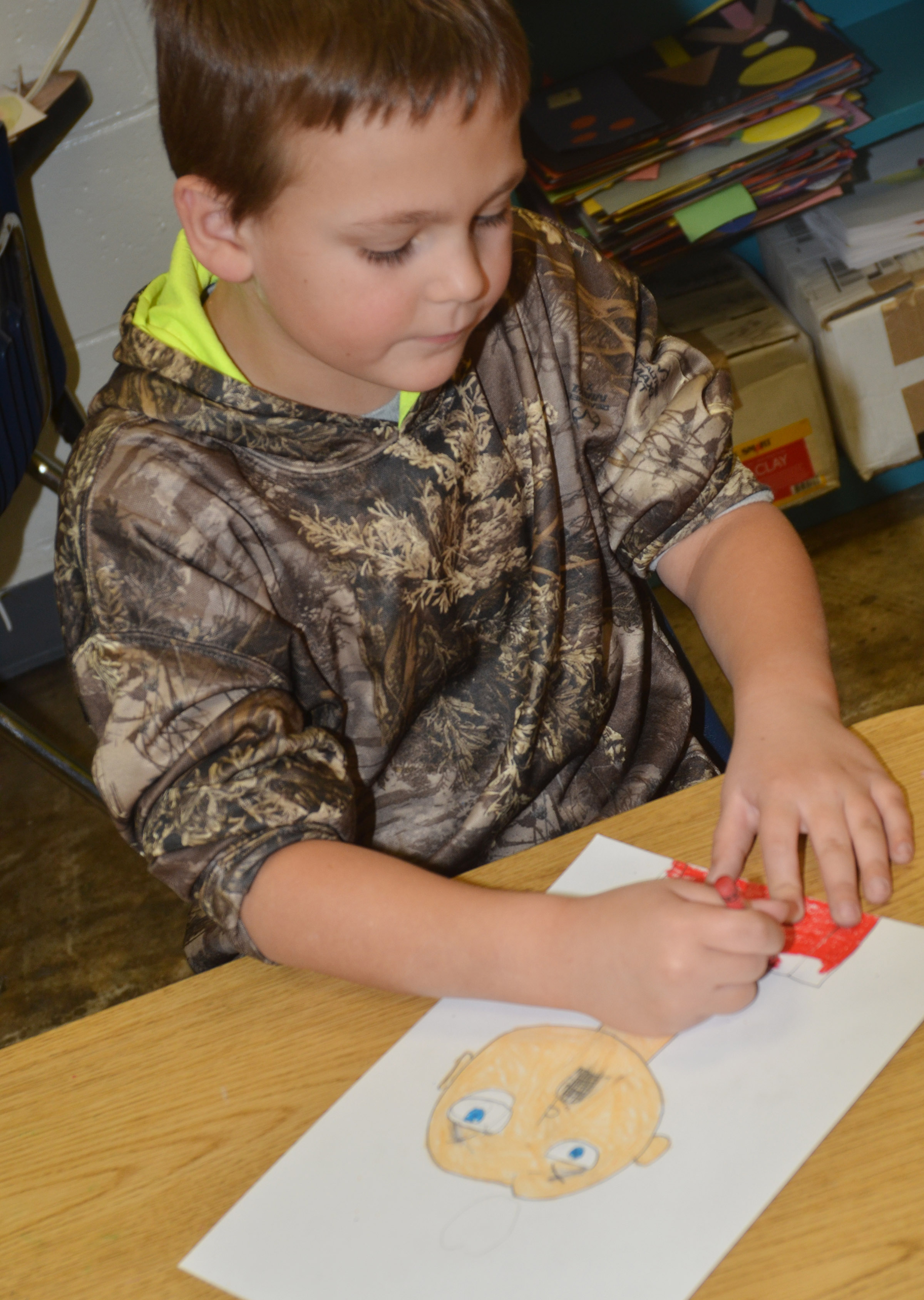 CES second-grader Brendan Martin colors his self-portrait.