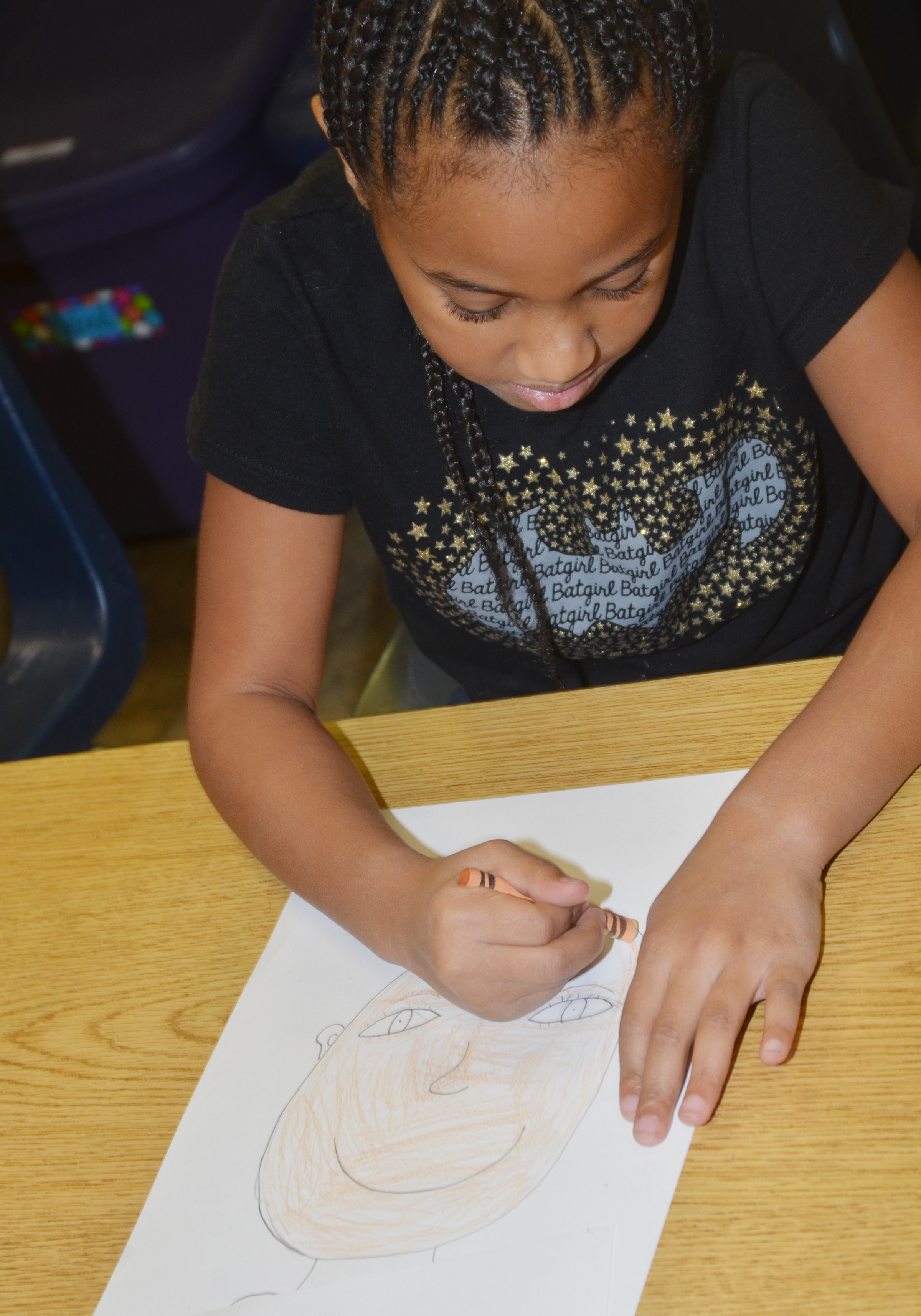 CES second-grader Kadance Ford colors her self-portrait.