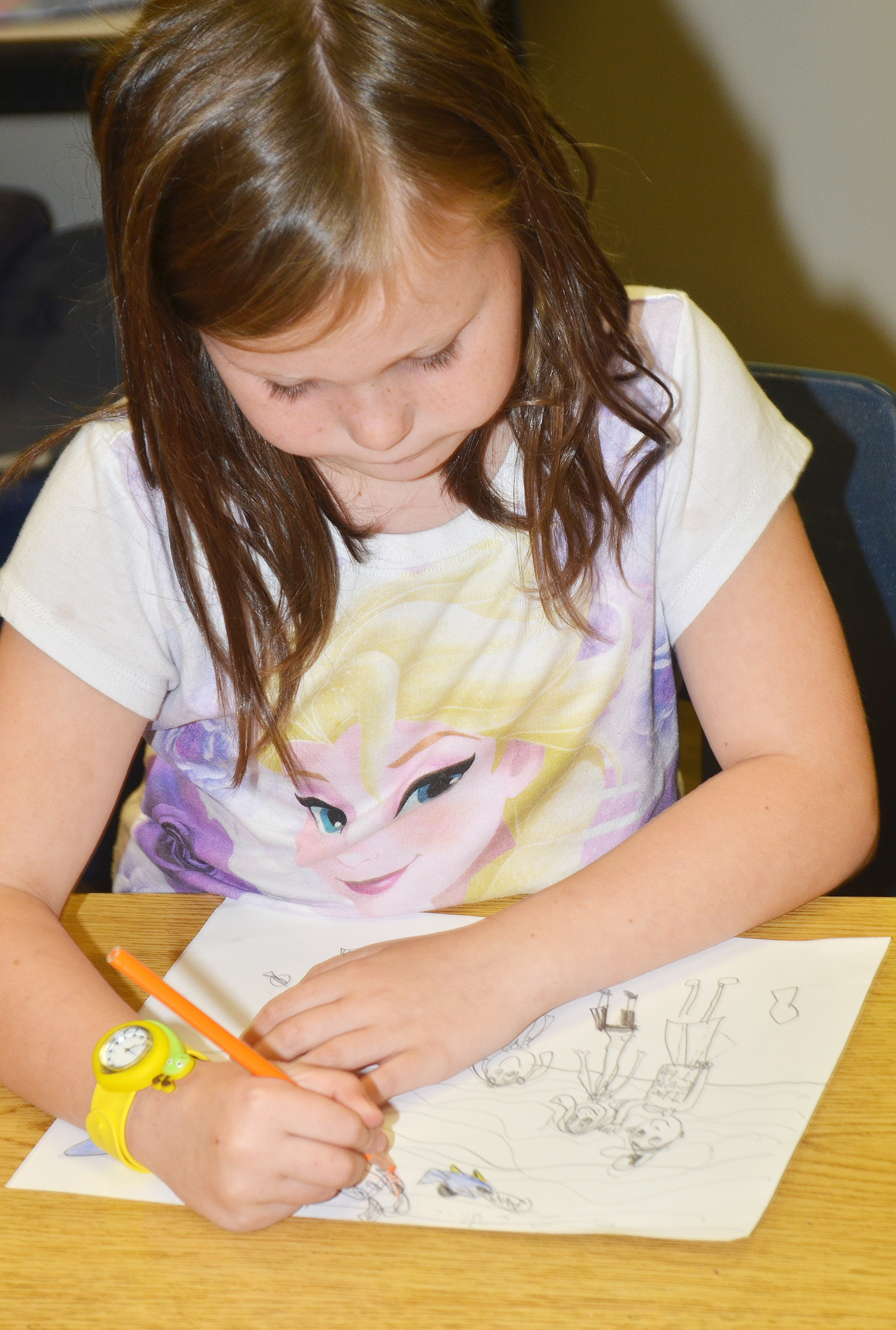 CES second-grader Cadynce Cox colors her family portrait.