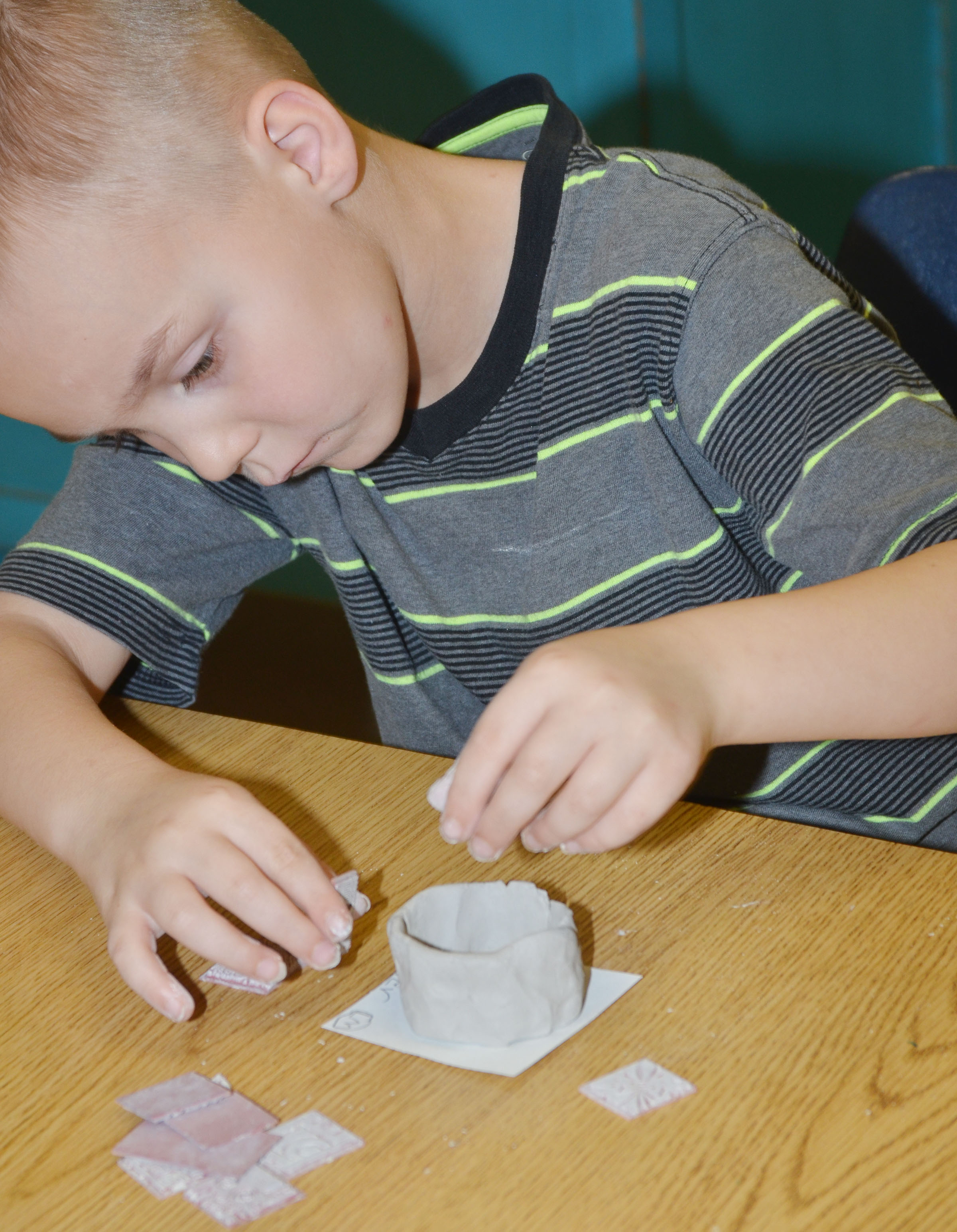 CES first-grader Hunter Bates shapes his pot.