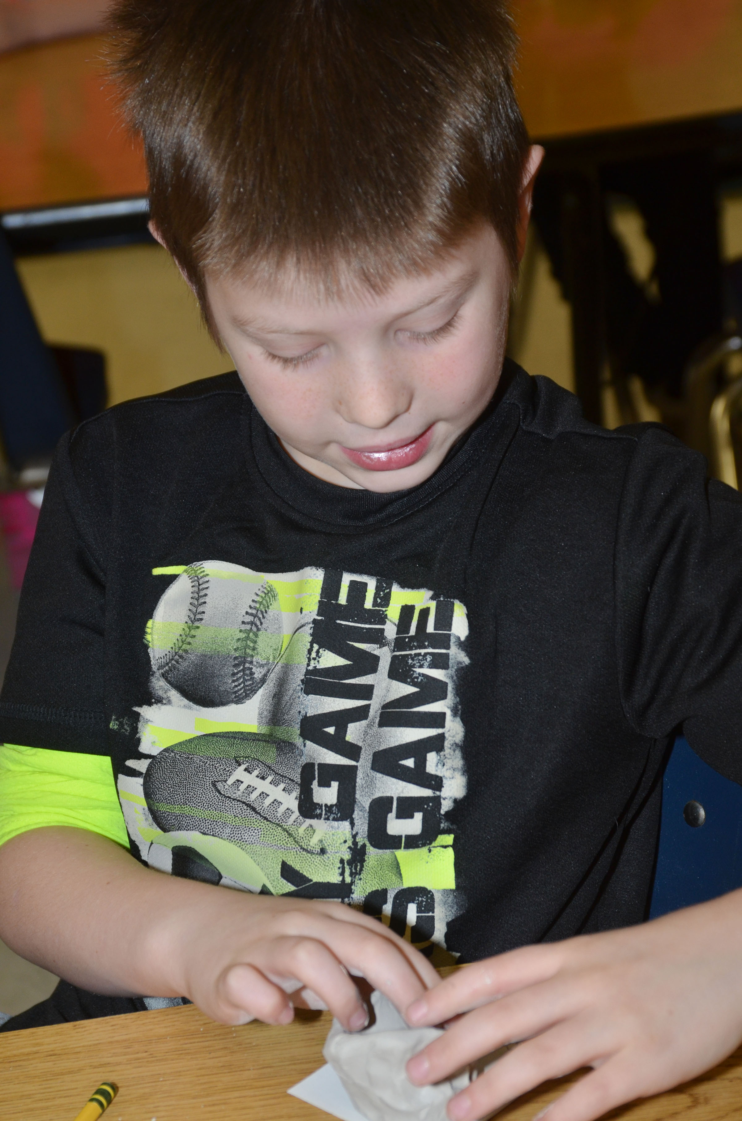 CES first-grader Brody Sidebottom shapes his pot.