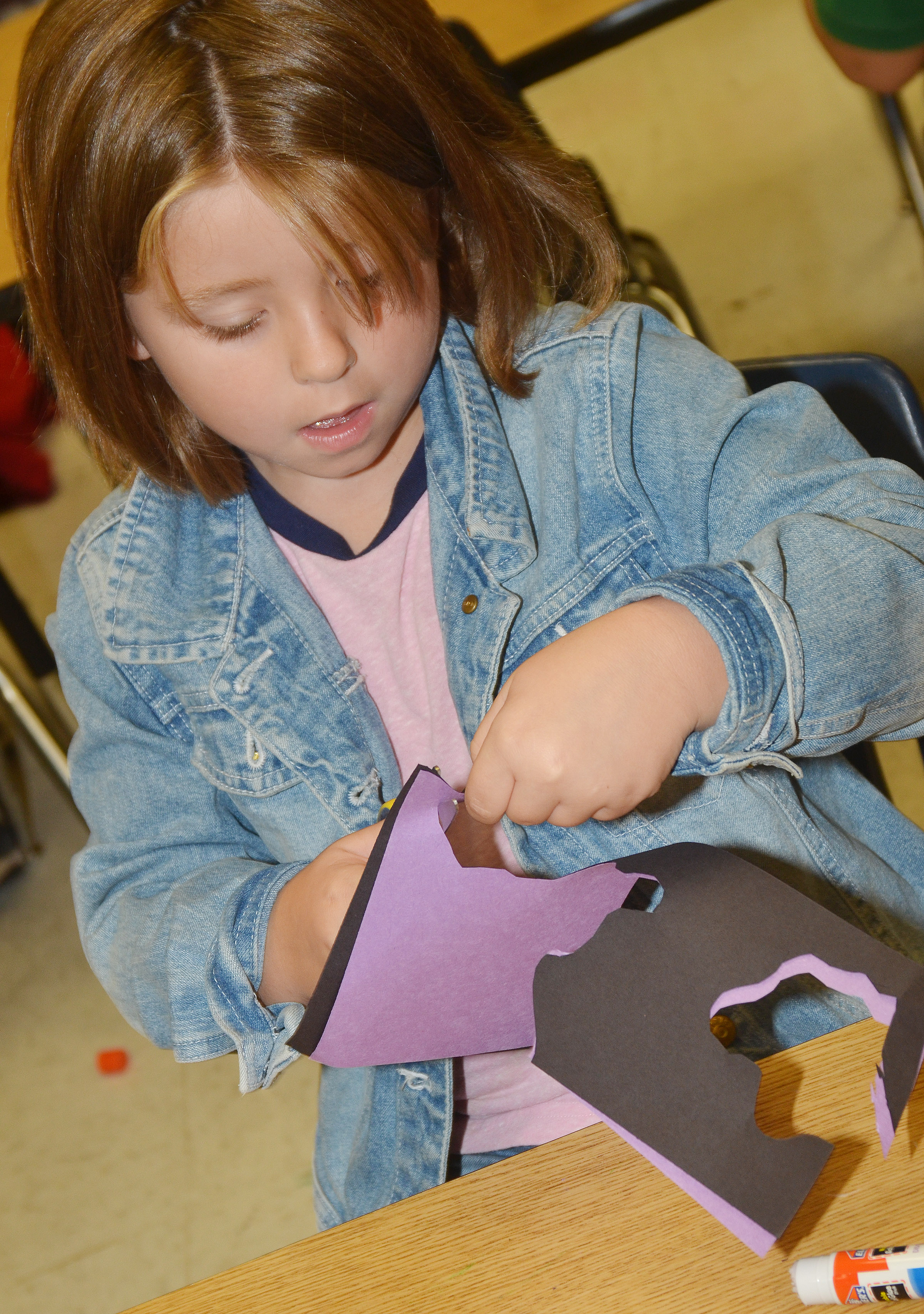 CES second-grader Sidney Sallee cuts out her free form shapes.